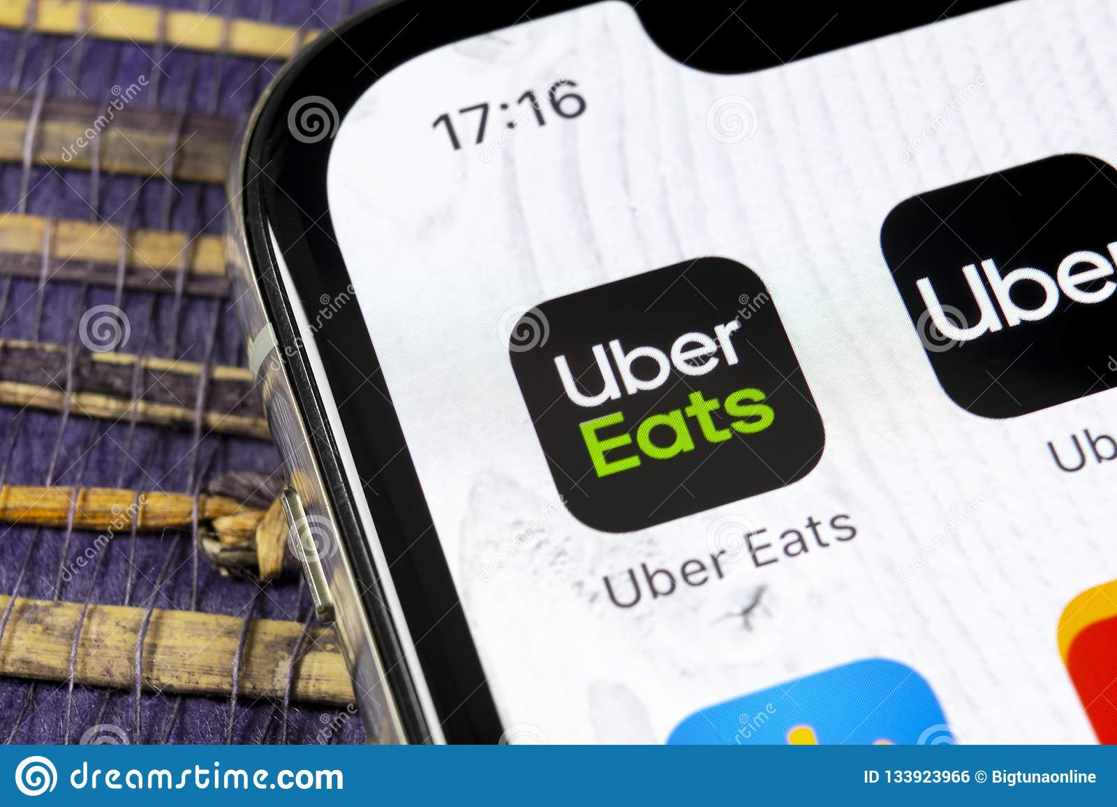 Uber Eats Application Icon On Apple IPhone X Smartphone Screen Close