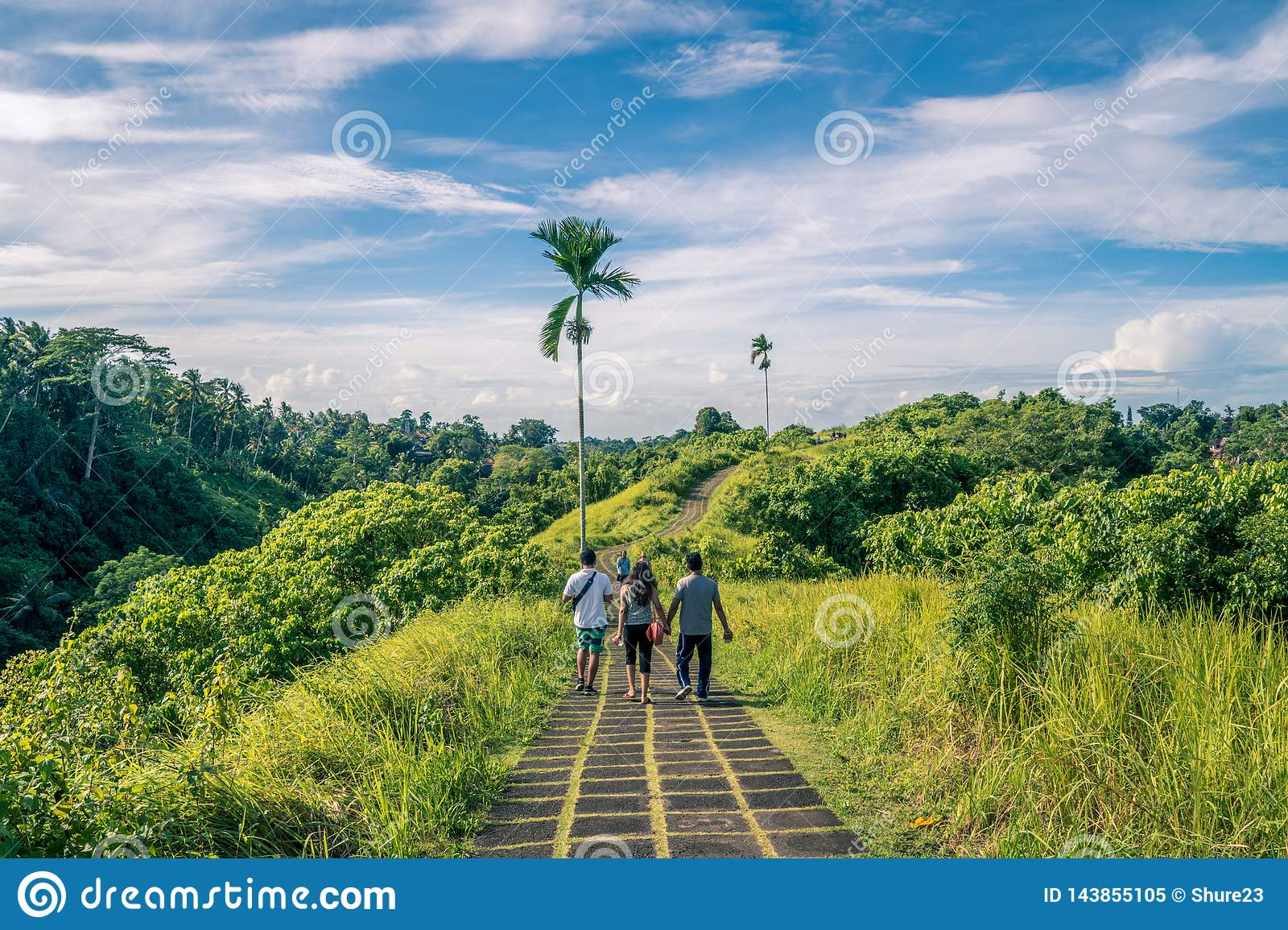 Tourist taking a guided tour of the ridge walk in Ubud