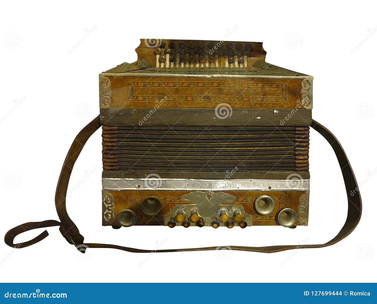 Uitstekende oude bruine houten die harmonika op witte achtergrond wordt geïsoleerd