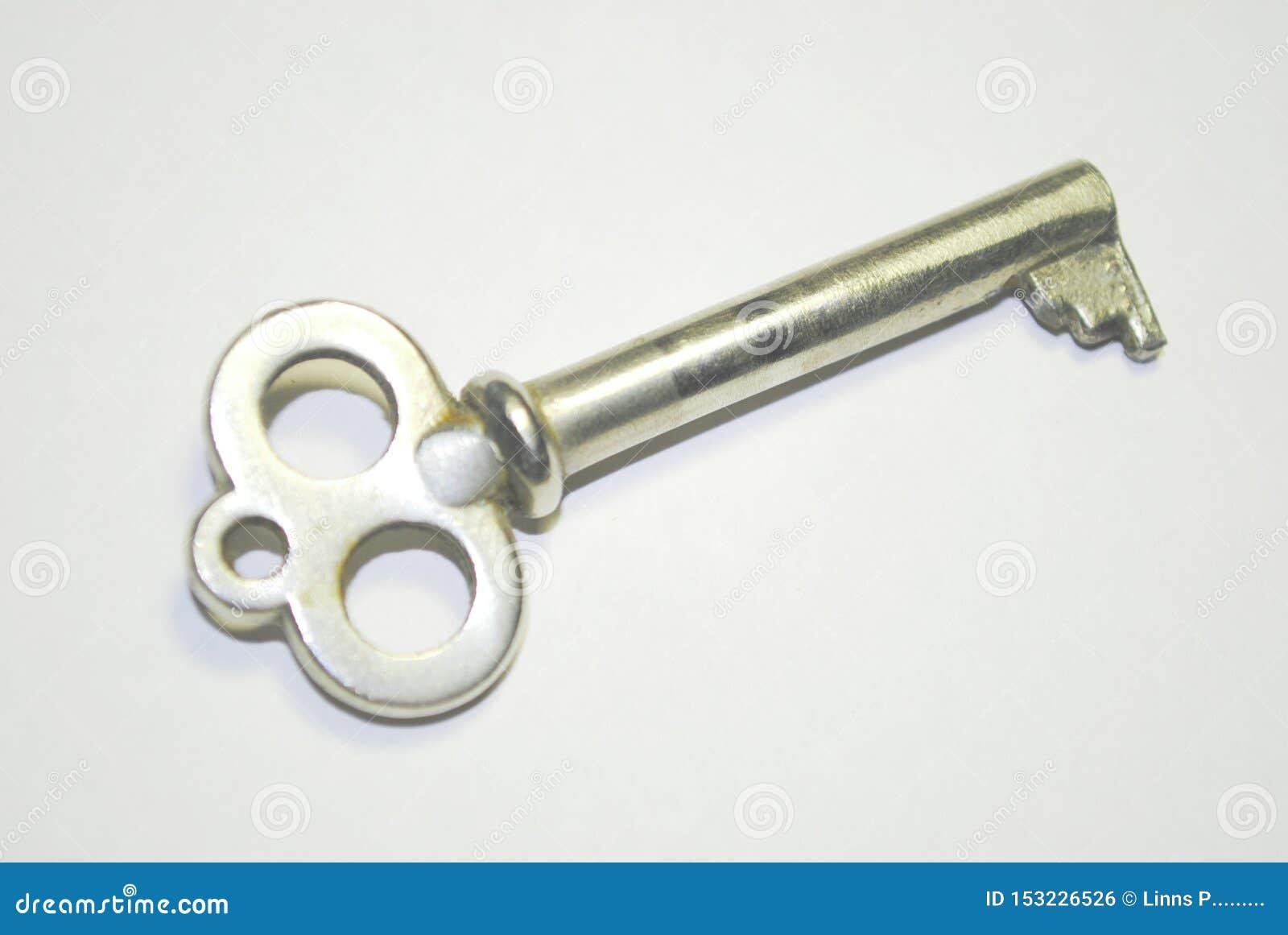 Uitstekende sleutel op witte achtergrond