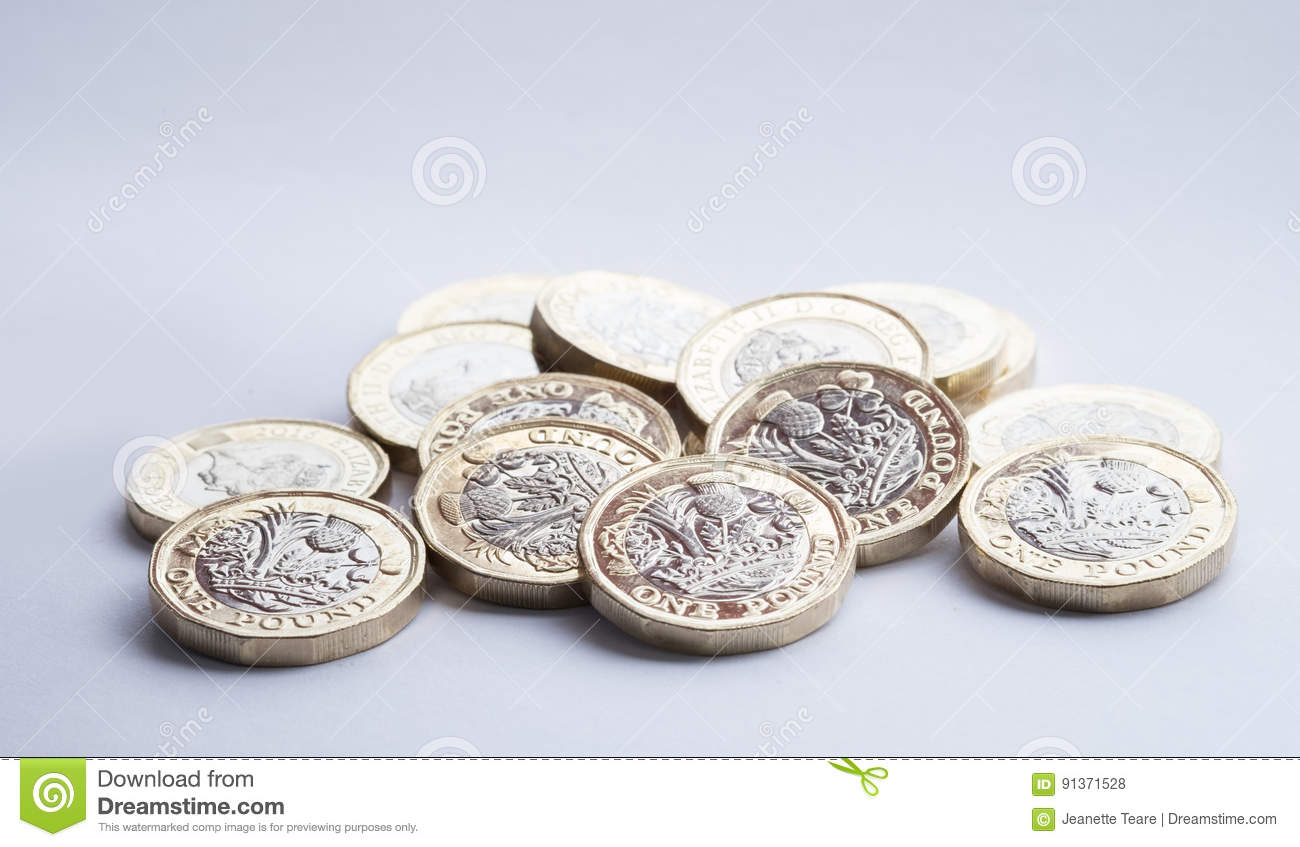 UK money, new pound coins in small pile