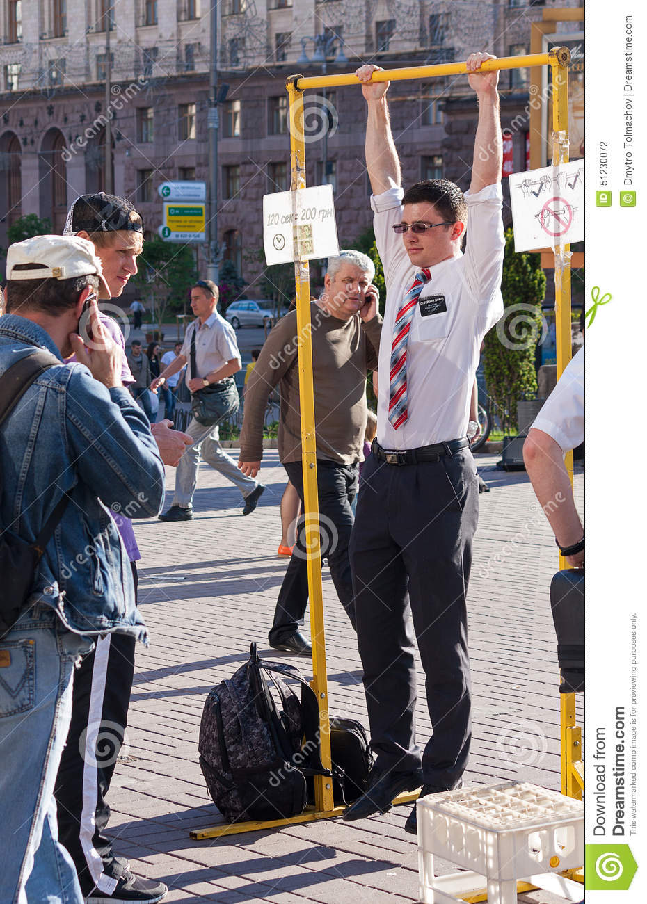 UKRAINE, KIEV - May 27, 2013: Young Missionary Tries His