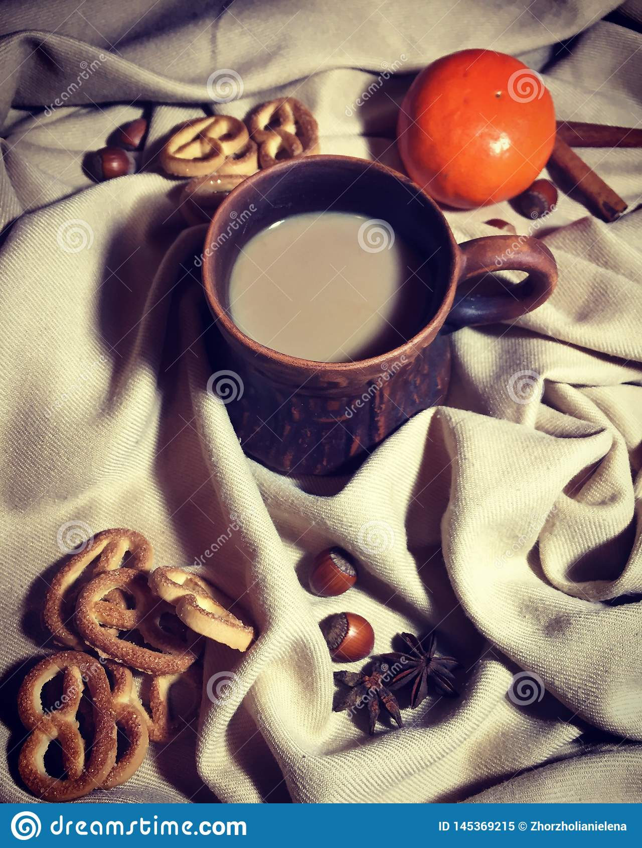 A cup of coffee with milk.