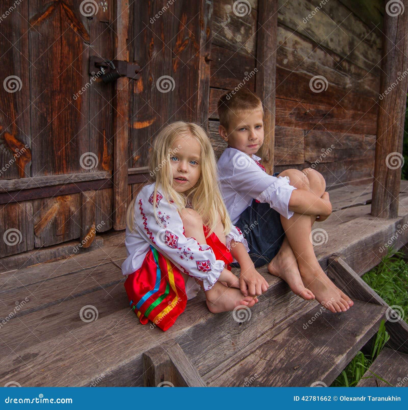 Ukrainian Children Near Old Wooden House Stock Photo