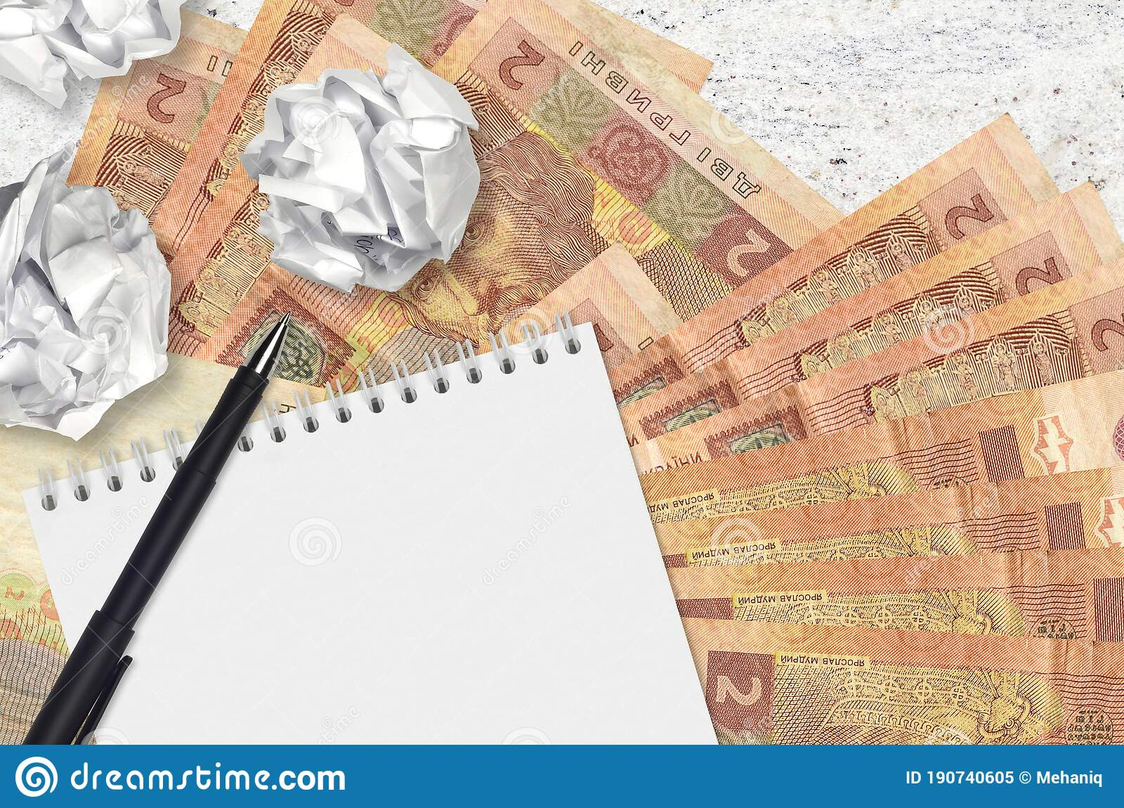 Picture of: 2 Ukrainian Hryvnias Bills And Balls Of Crumpled Paper With Blank Notepad Bad Ideas Or Less Of Inspiration Concept Searching Stock Image Image Of Bills Business 190740605