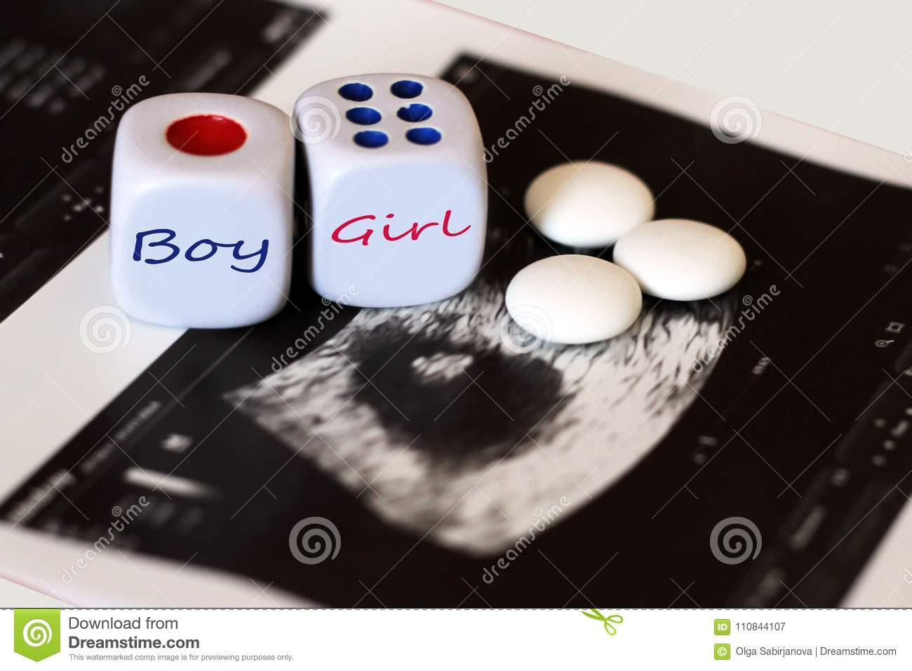 Ultrasound of baby in mother`s womb. Playing cubes with inscriptions and tablets.