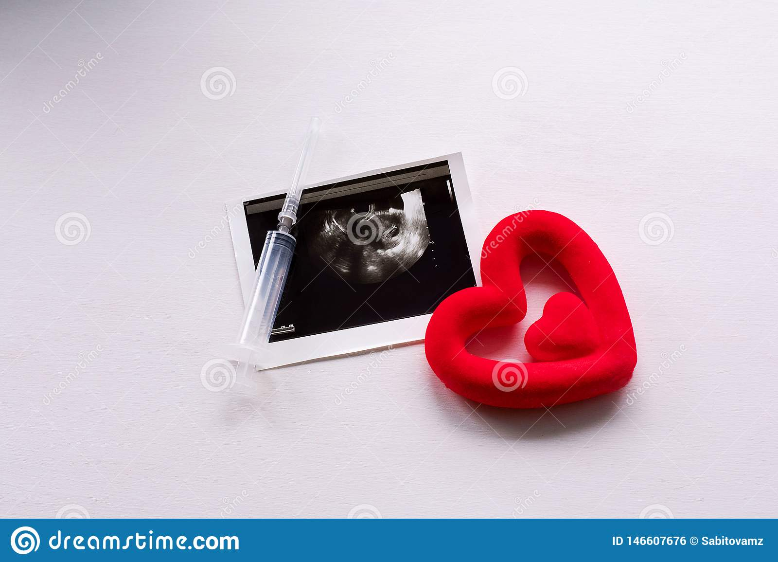 Ultrasound scan of the child and the heart on a white background