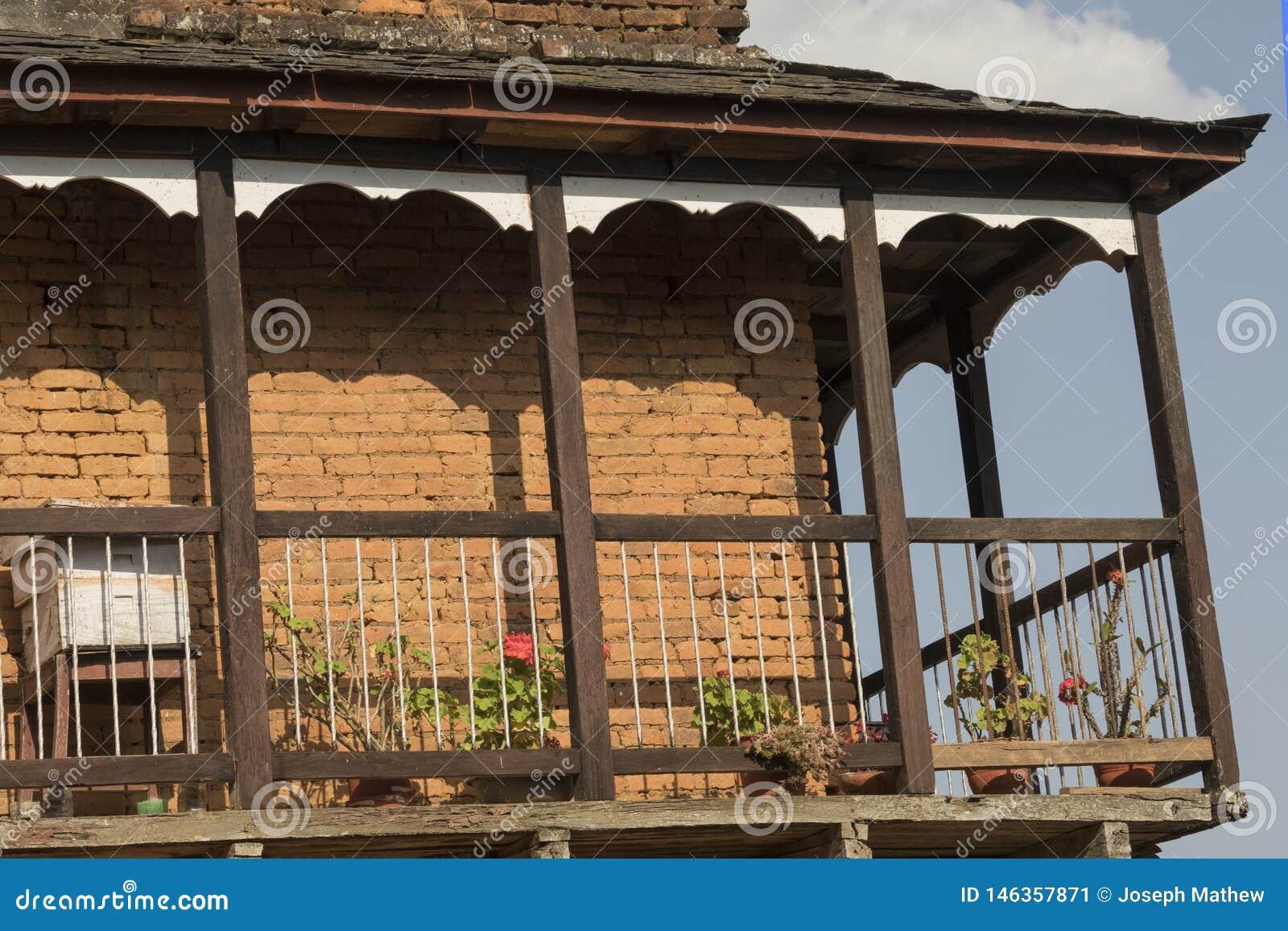 Um balcão tradicional da casa em Bandipur Nepal