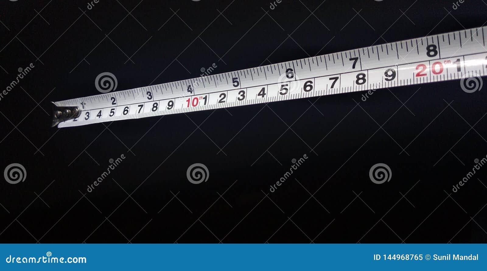 Um fim acima de uma fita da medida