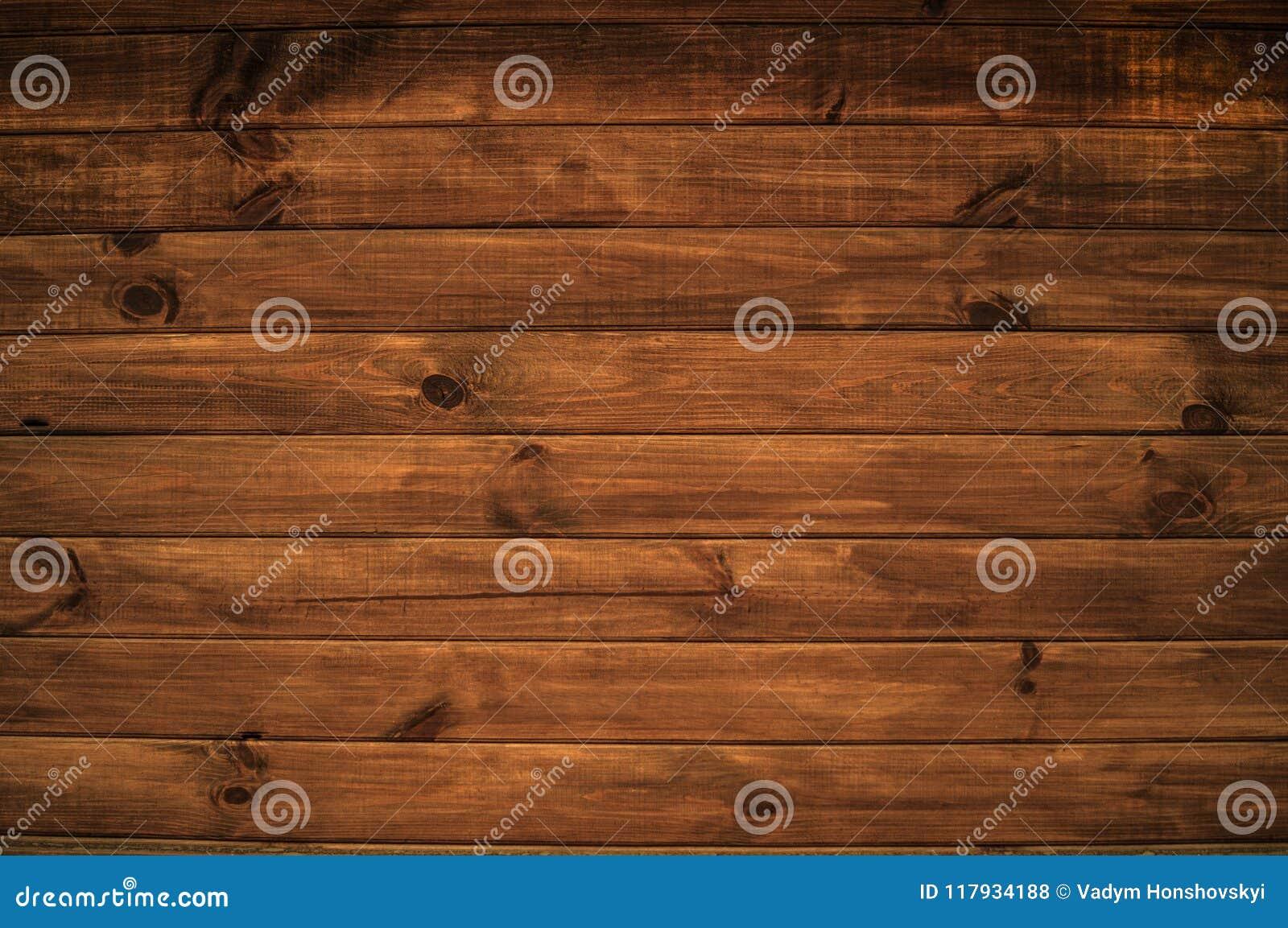 Um fundo com uma estrutura bonita de placas de madeira horizontais da cor marrom