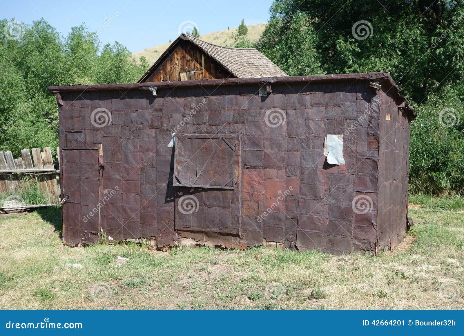 Um ol, casa do goldrush feita com latas do biscoito em idaho