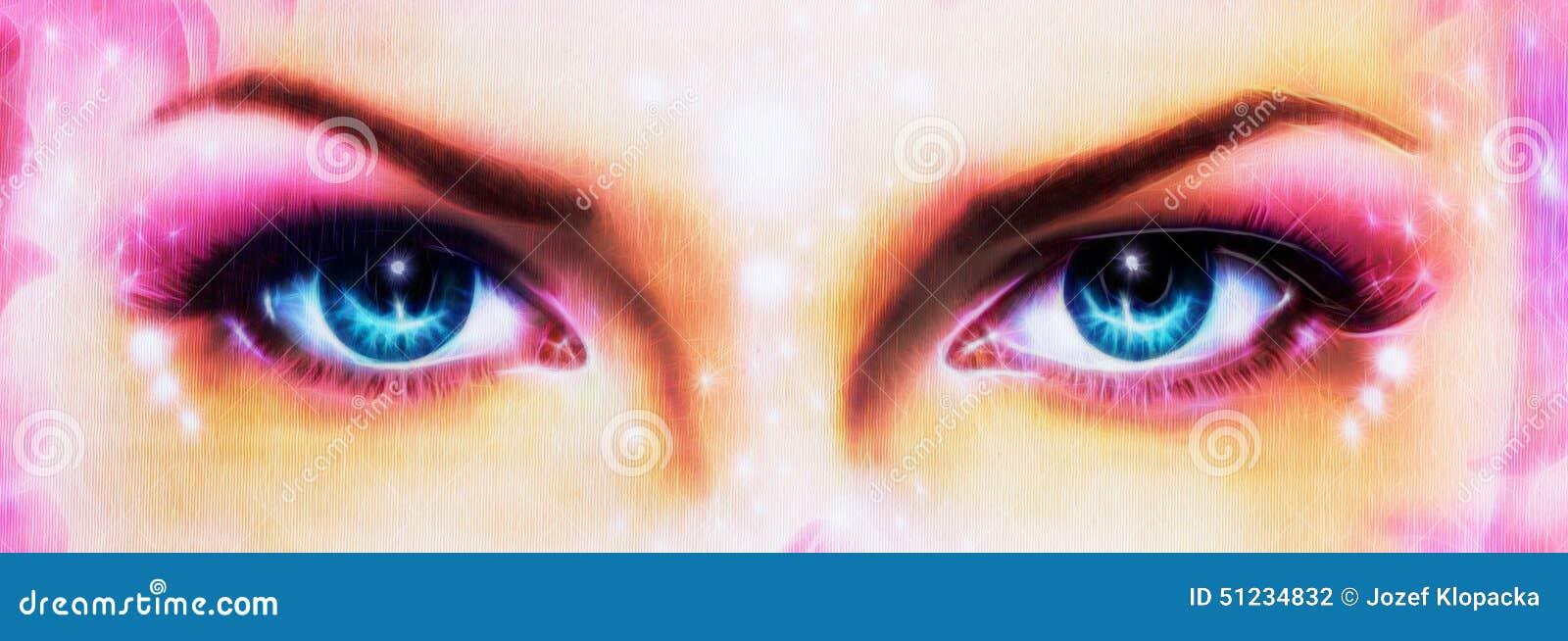 Um par de mulheres azuis bonitas eyes a irradiação acima de encantar de