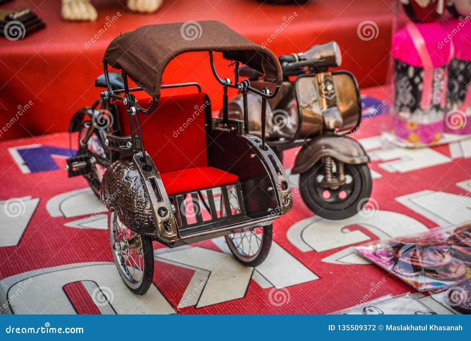 Um transporte tradicional do vintage da miniatura pequena do pedicap