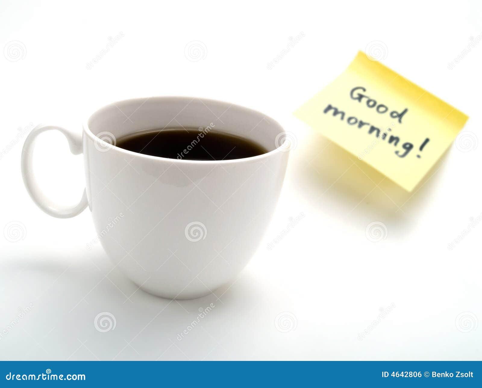 Uma chávena de café e uma nota amarela