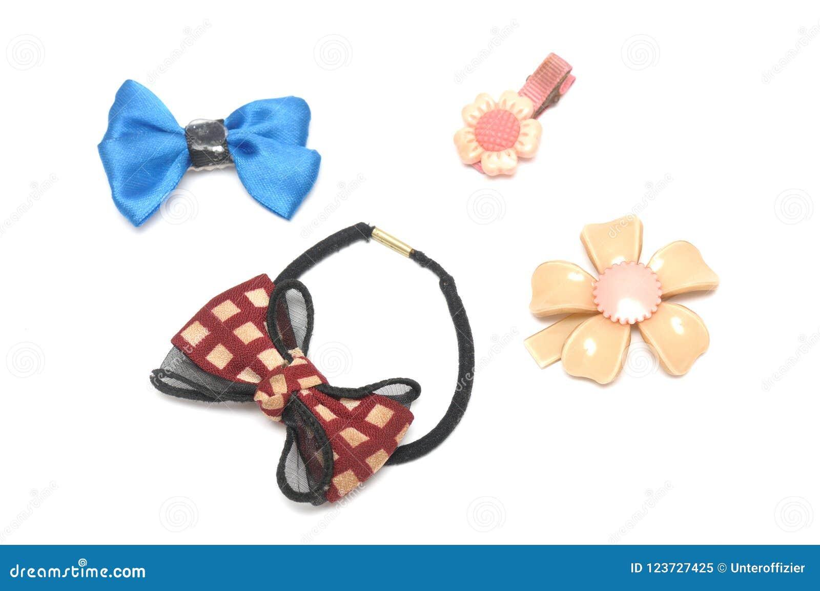 Uma faixa do cabelo e alguns grampos de cabelo de projetos floridos e da fita