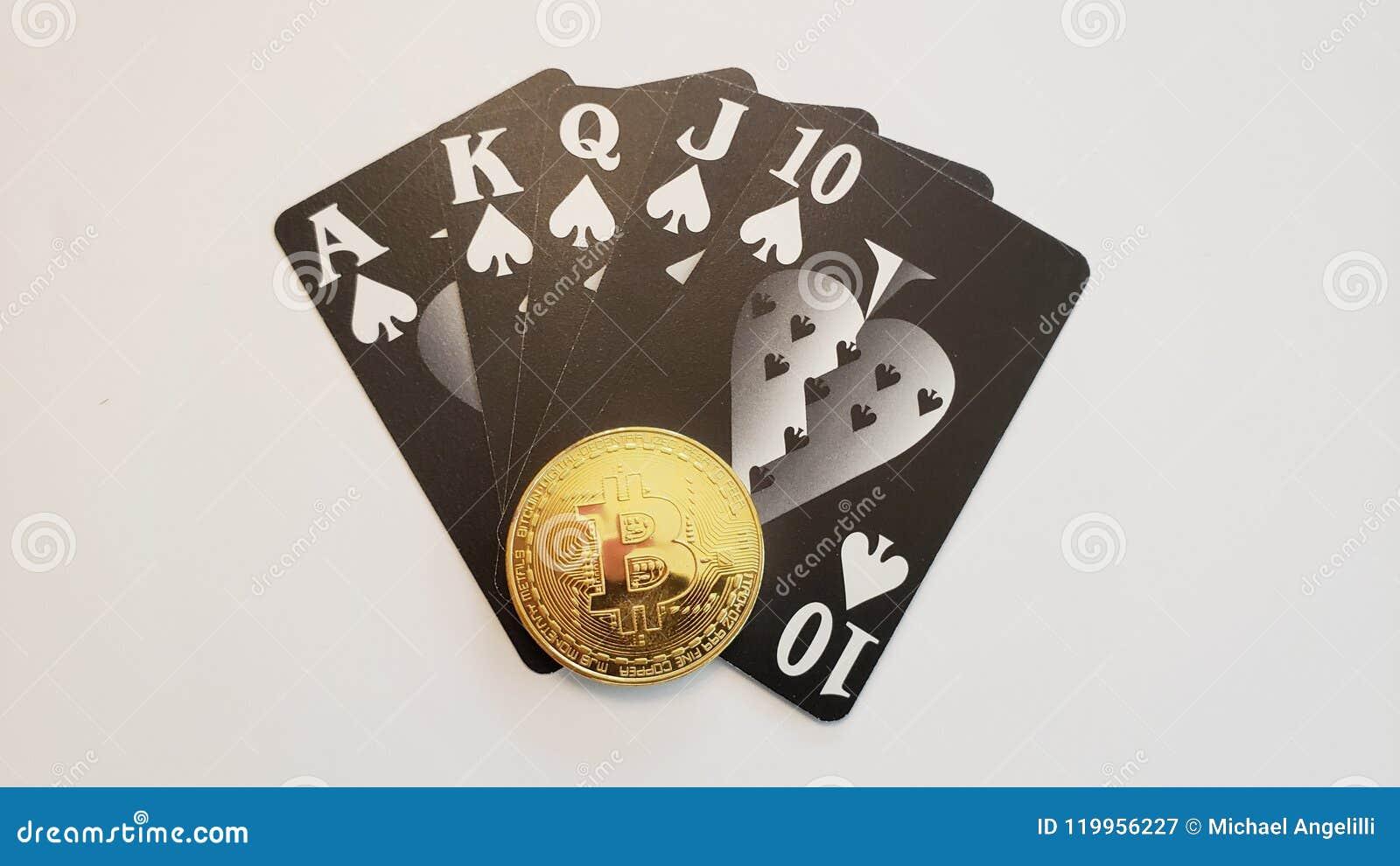 Uma mão de pôquer do resplendor reto com botão do negociante