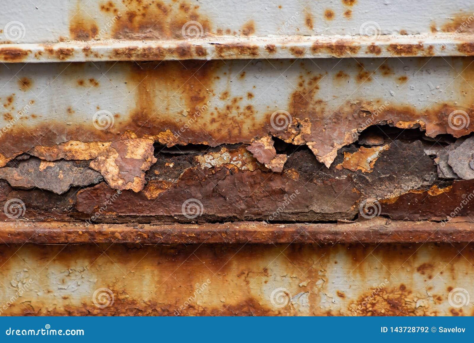 Uma parte de metal com corrosão