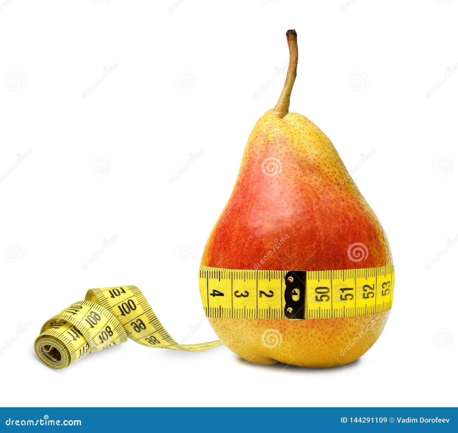 Uma pera do dieter mede sua cintura e é satisfeita para notar que tudo é muito bem com o tamanho Símbolo da nutrição apropriada