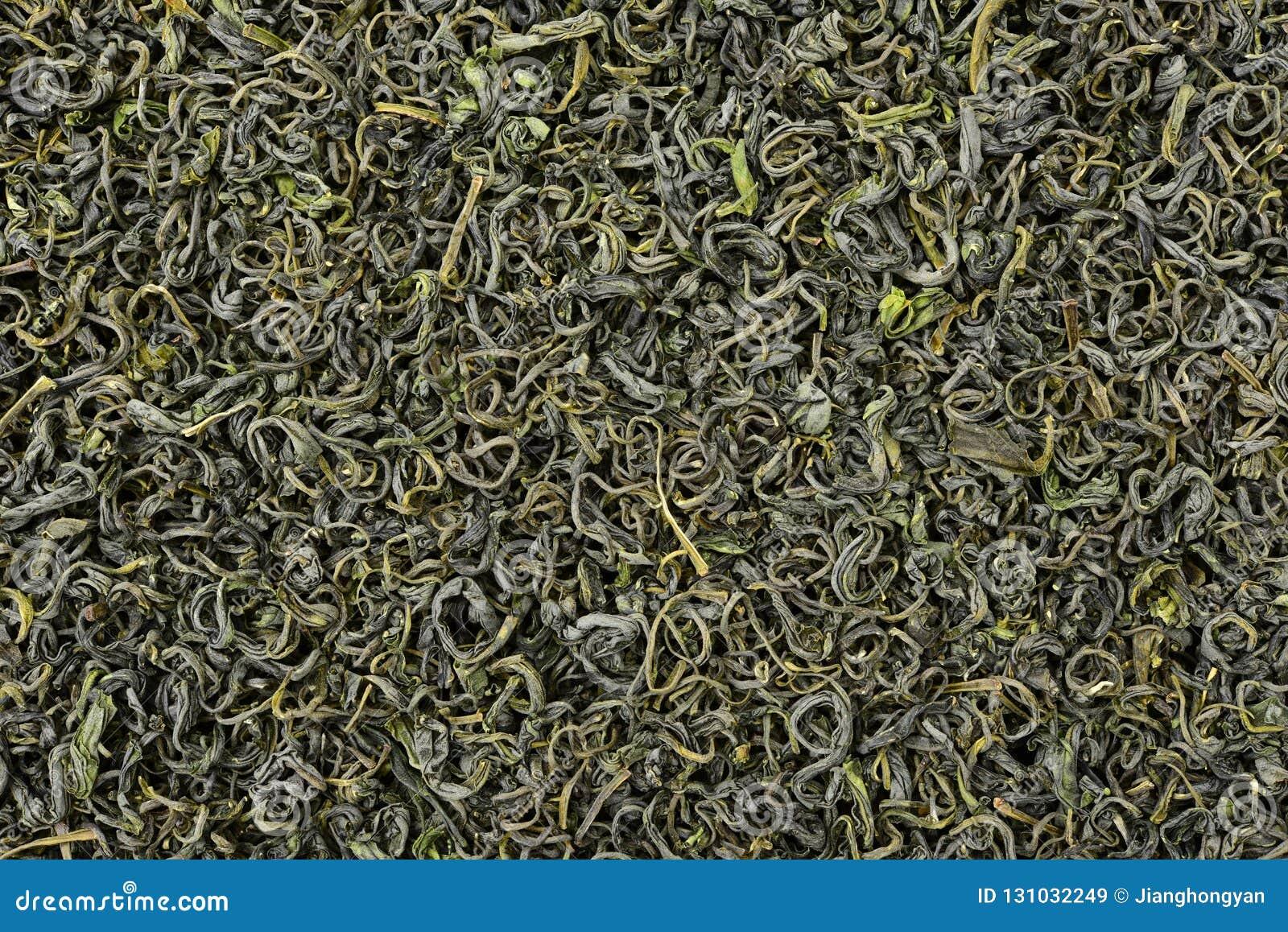 Uma pilha do chá verde seco