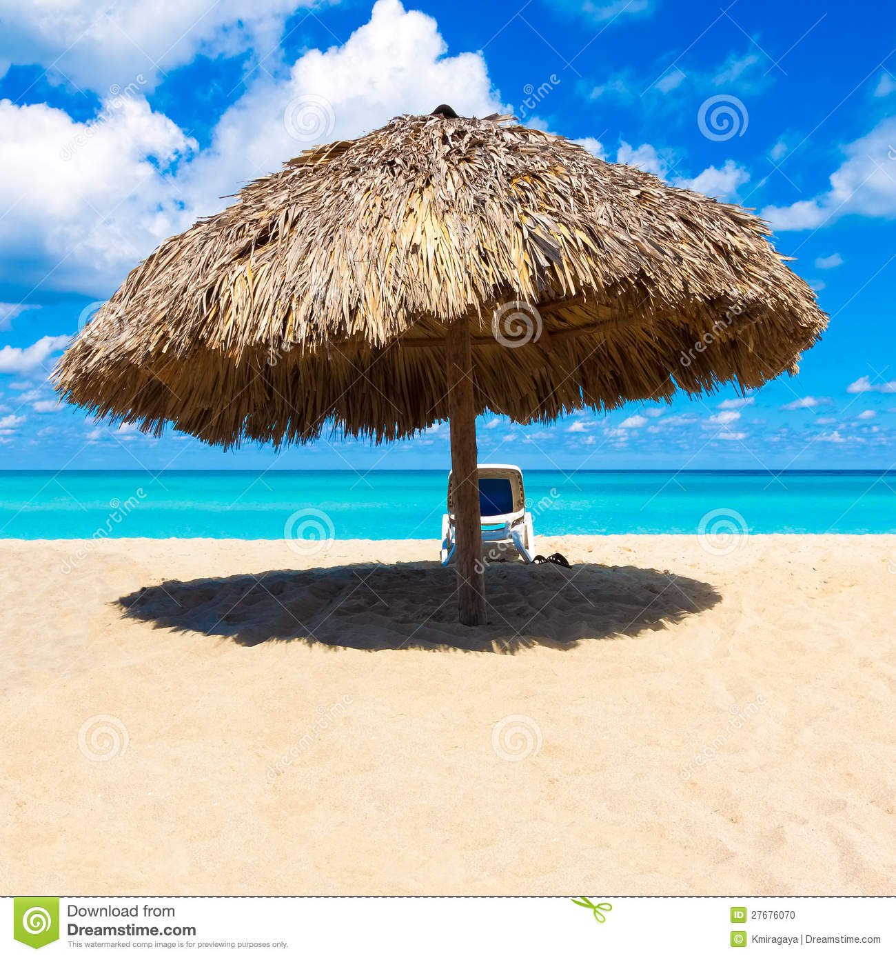 Caribbean Beach: Umbrella And Beach Bed On A Caribbean Beach Stock Photo