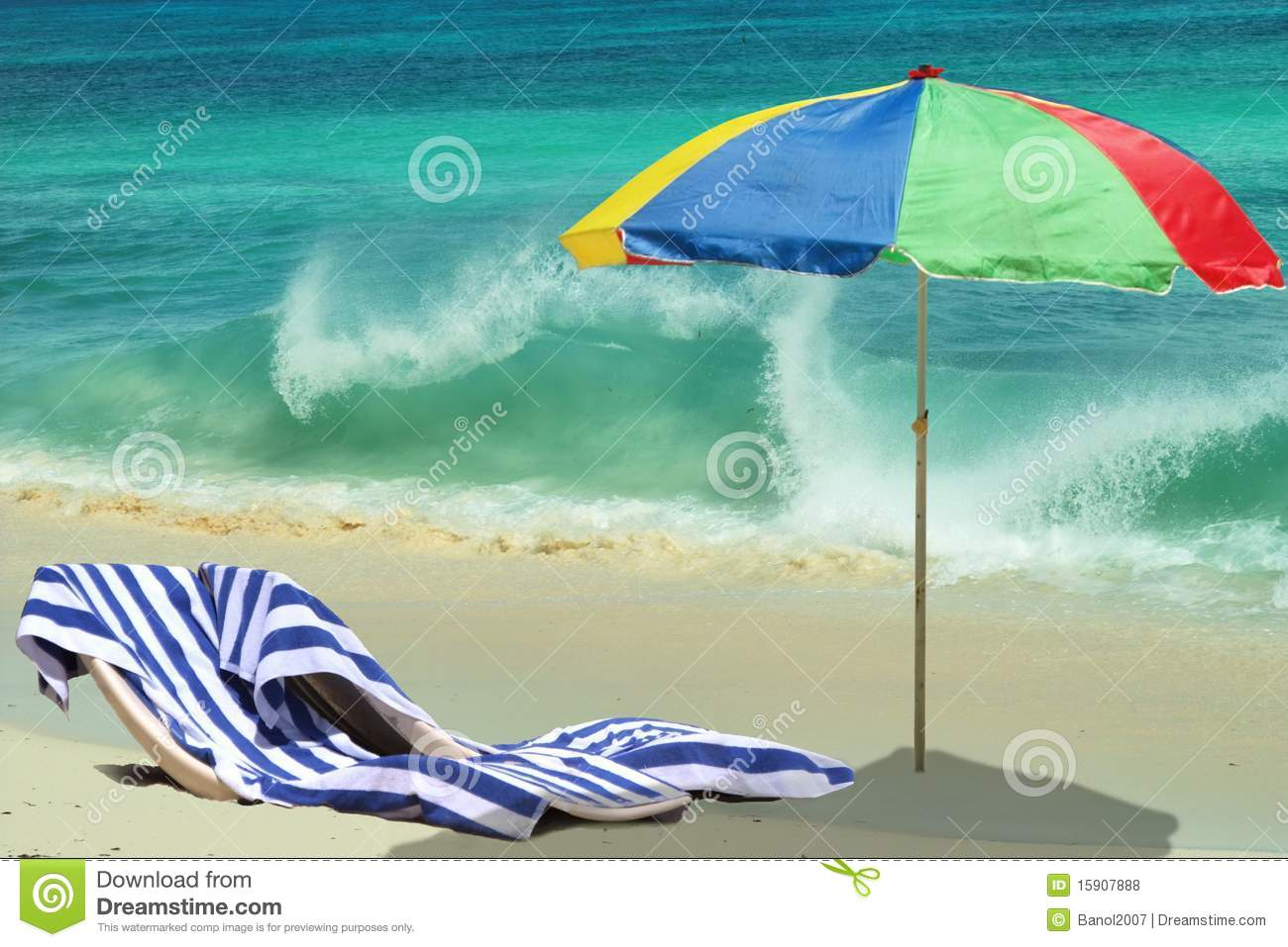 Umbrella, chairs on beach. Playing sea wave