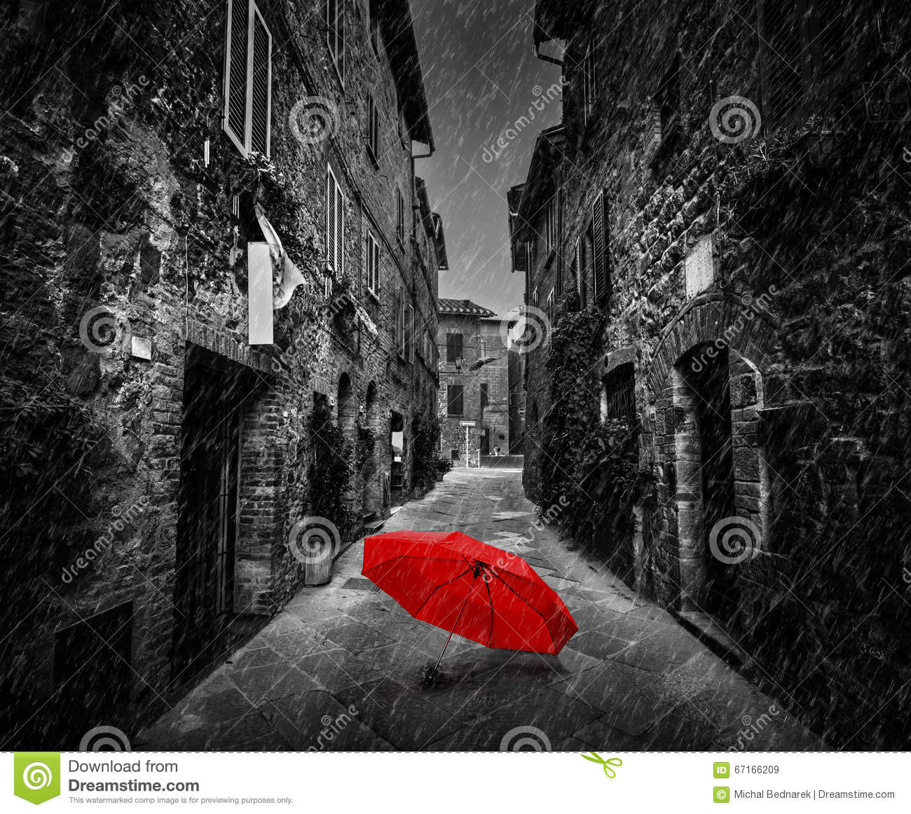 Umbrella On Dark Street In An Old Italian Town In Tuscany Italy