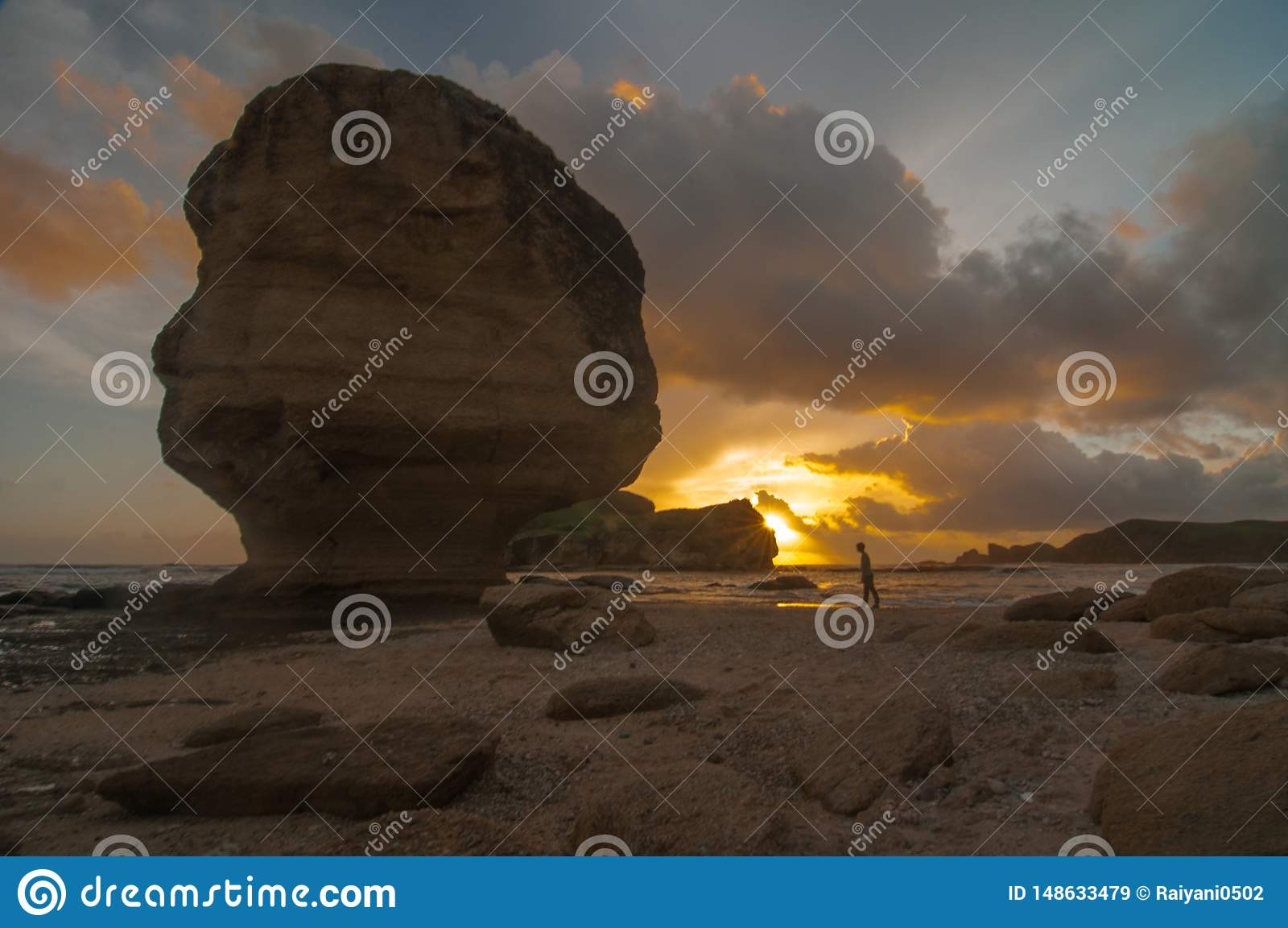 Sunset at Umbrella stone beach at mandalika Lombok