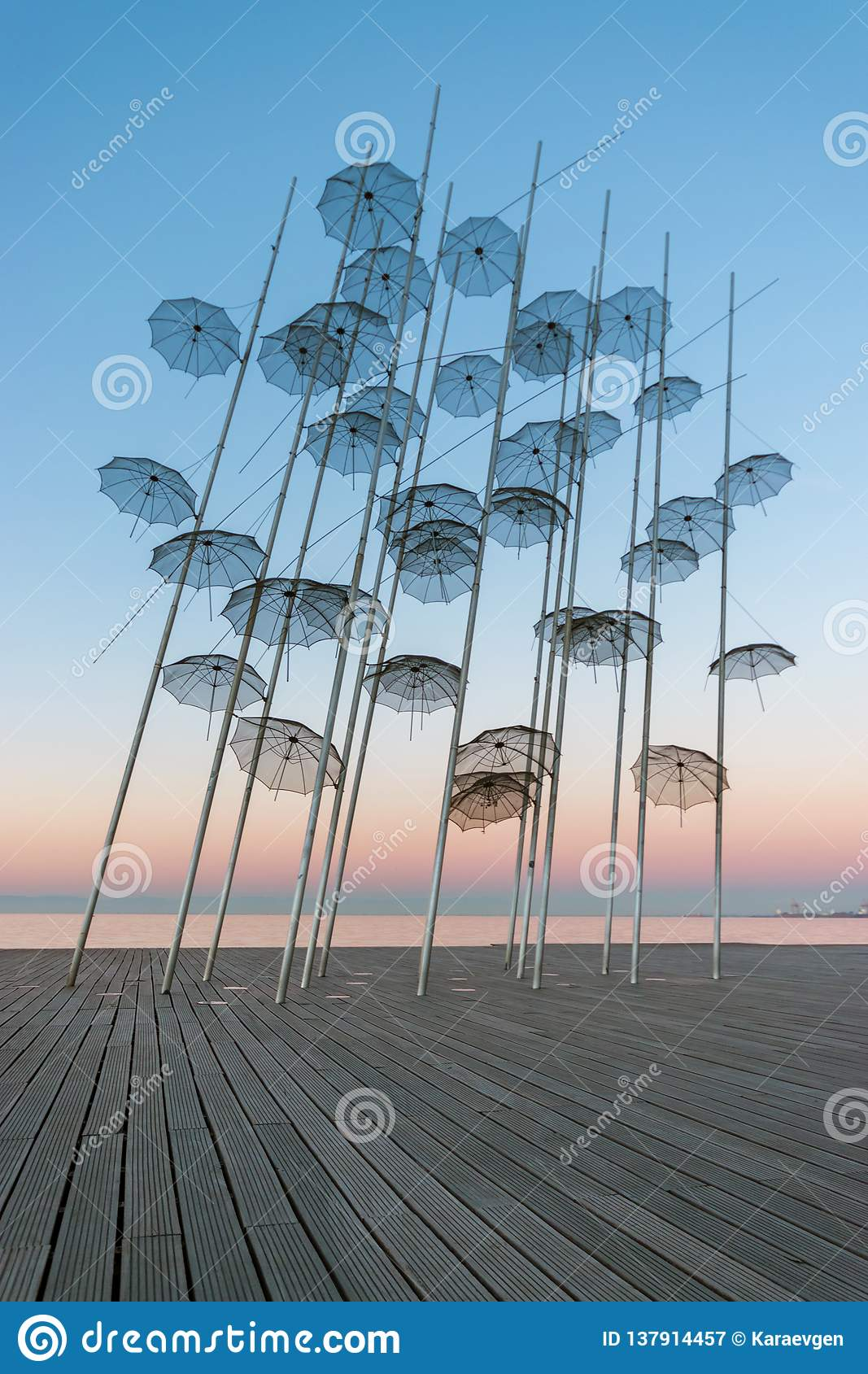 The `Umbrellas` installation at the New Waterfront of Thessaloniki during sunrise in Greece