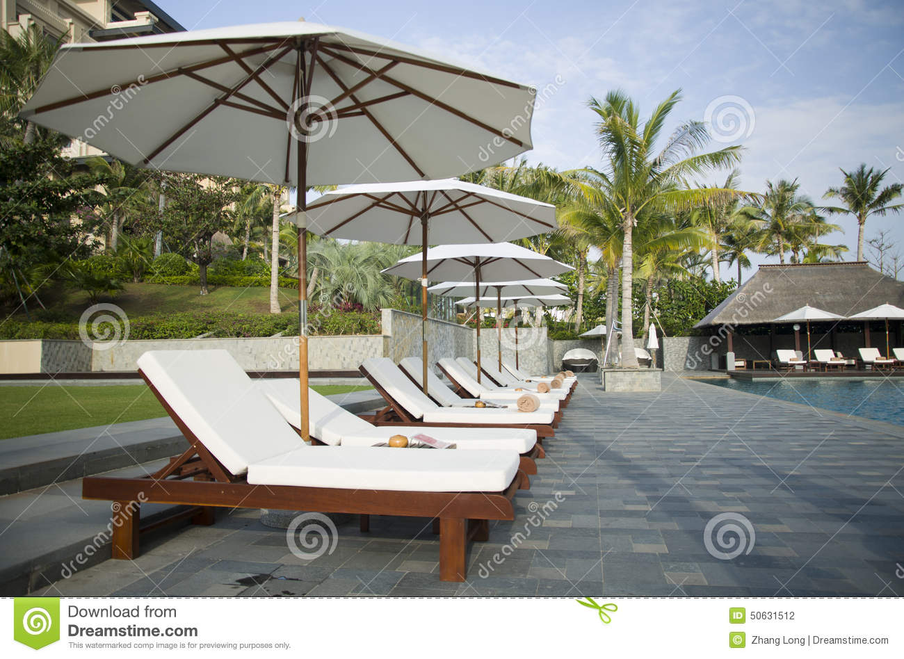 Dining Table By Swimming Pool On Patio Royalty Free Stock Photo 33897357