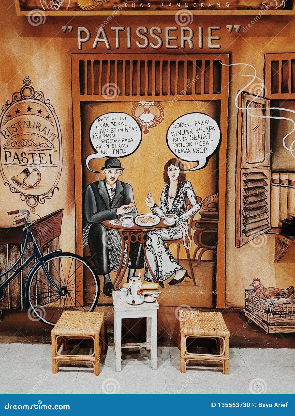 Un arte murala di una pasticceria mangiatrice di uomini con una donna