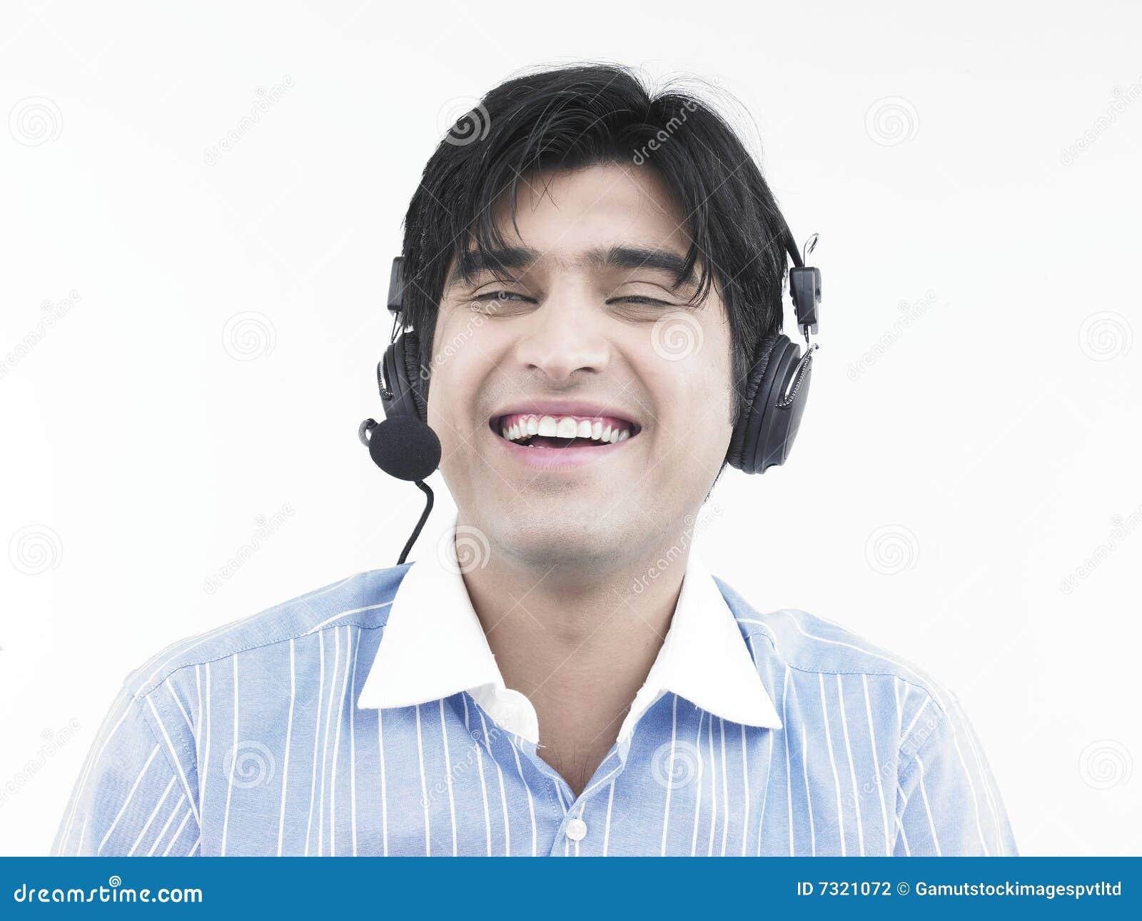 Un esecutivo di risata del centro di chiamata