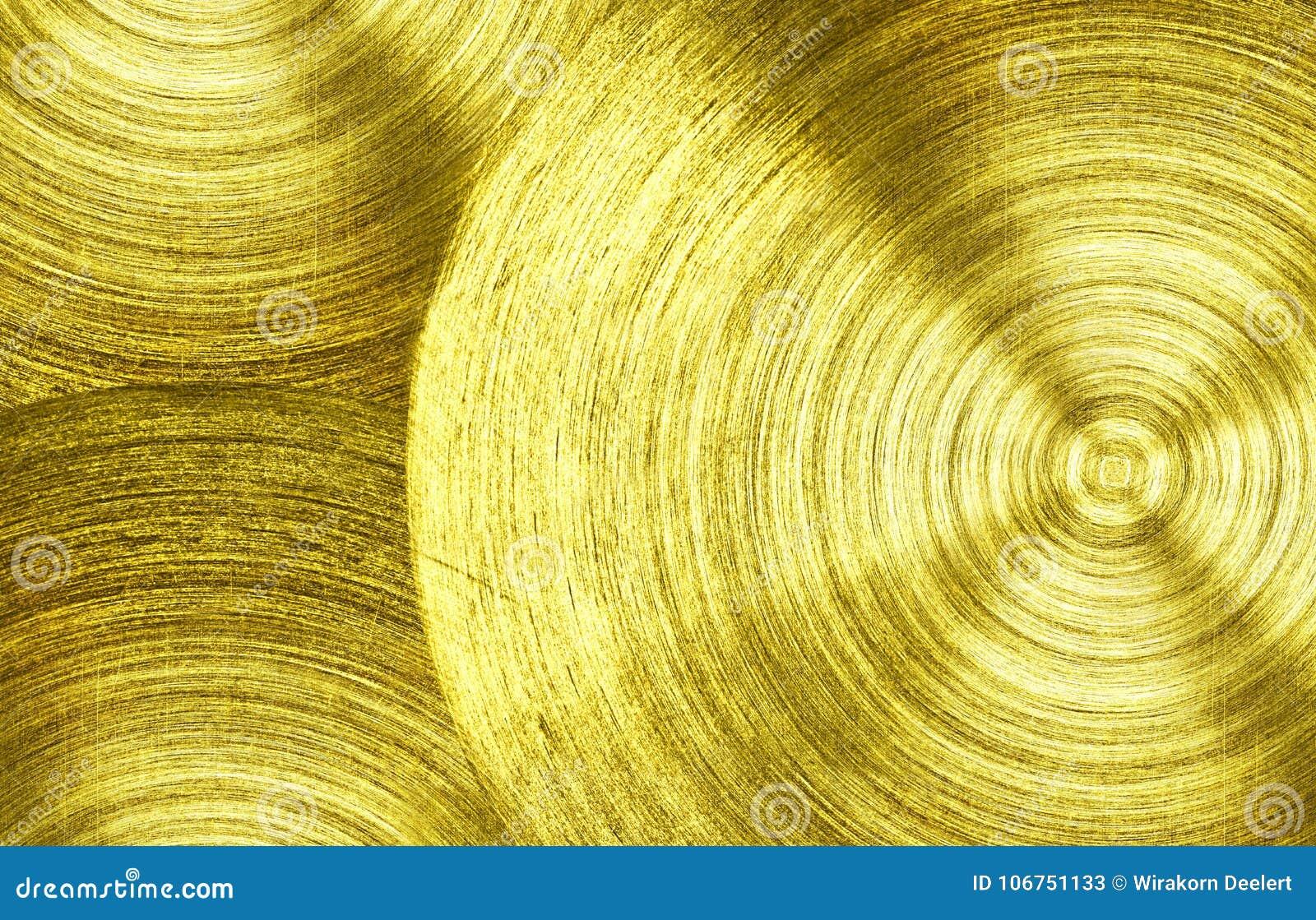 Un fer d or en métal avec le fond circulaire de texture