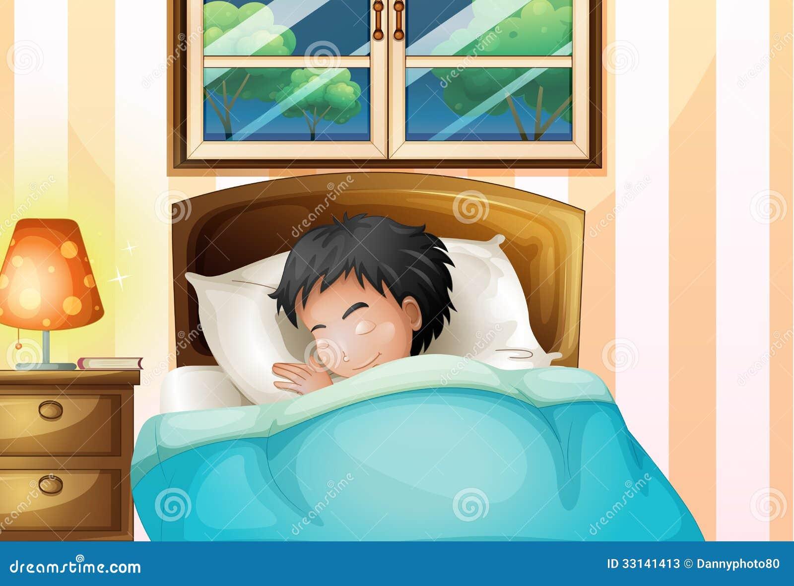 Un garçon dormant solidement dans sa chambre