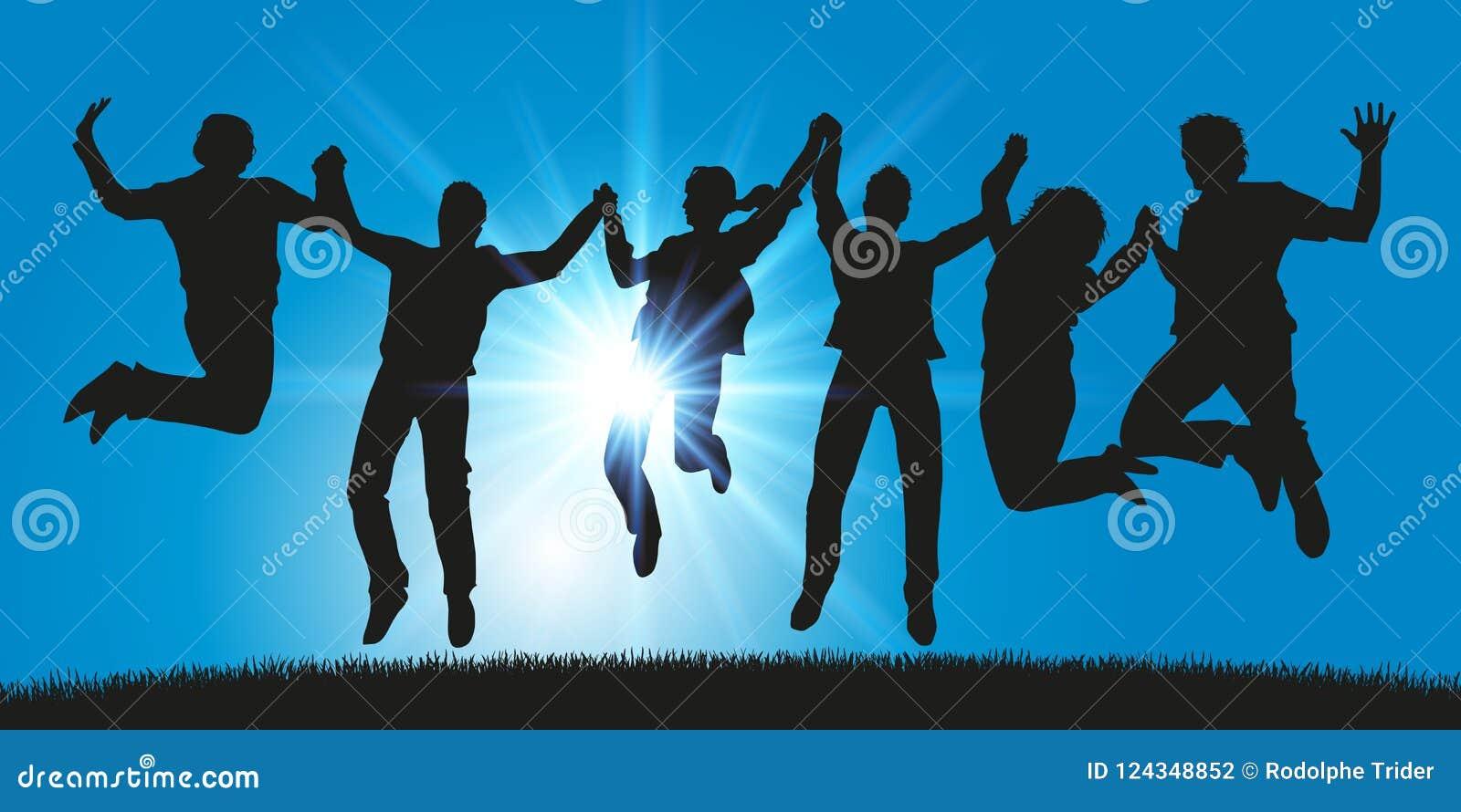 Un grupo de gente joven salta para la alegría que lleva a cabo las manos
