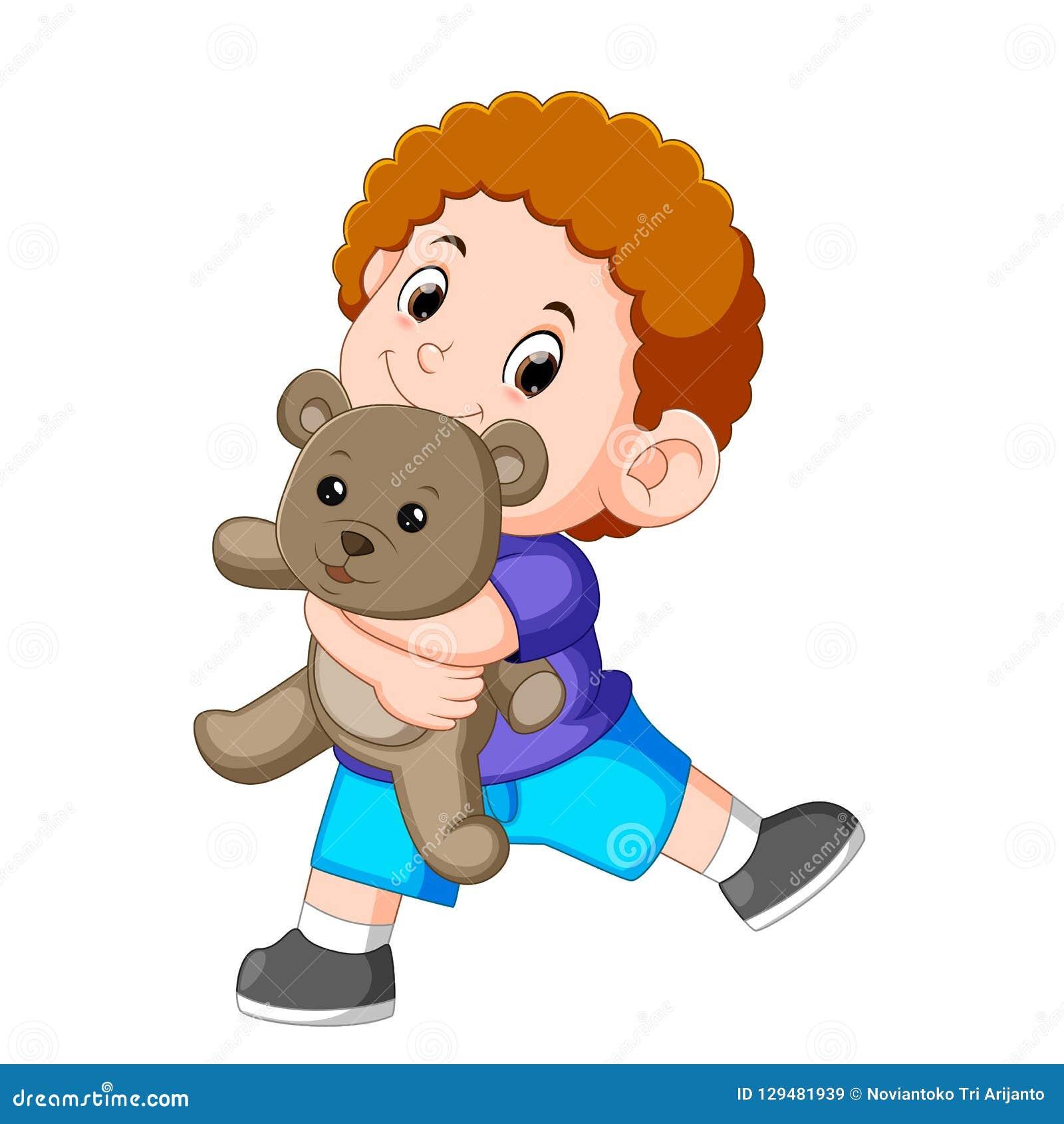 Un jeu heureux de garçon avec l ours de nounours gris