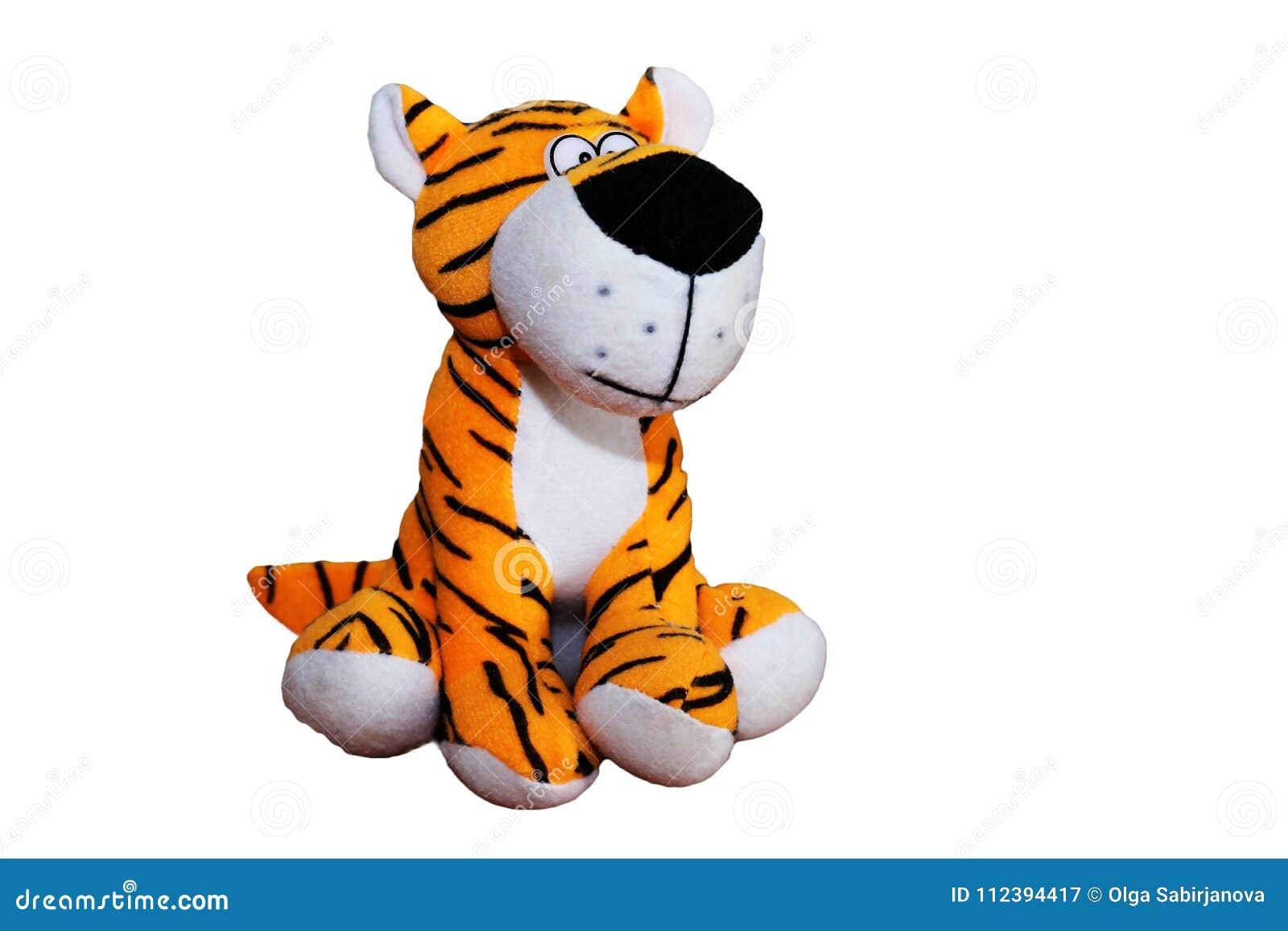 Un juguete suave del tigre suave hermoso en un fondo blanco
