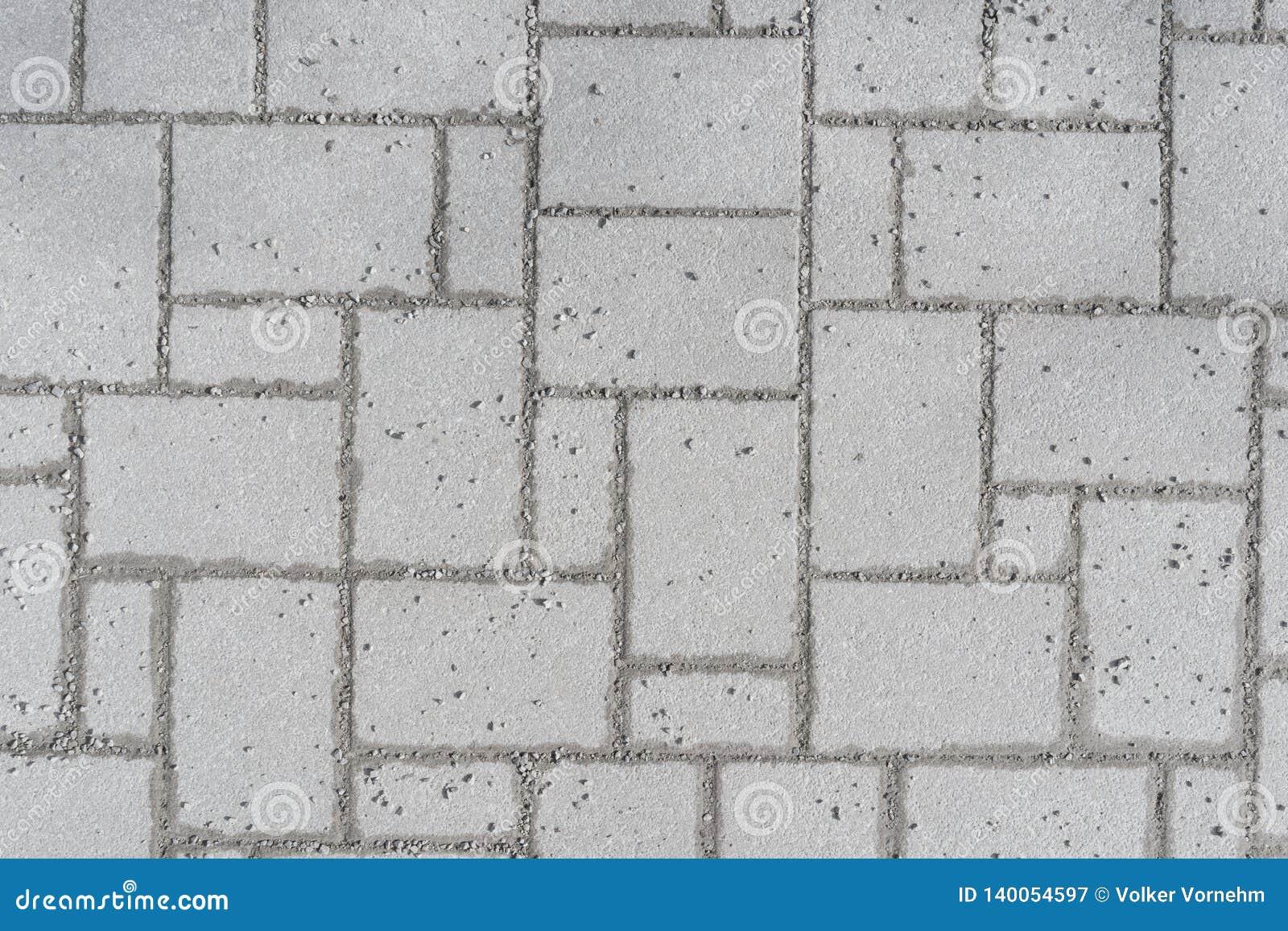 Un modelo de un pavimento del romano tomado desde arriba en un parque, ejecutado con los guijarros grises