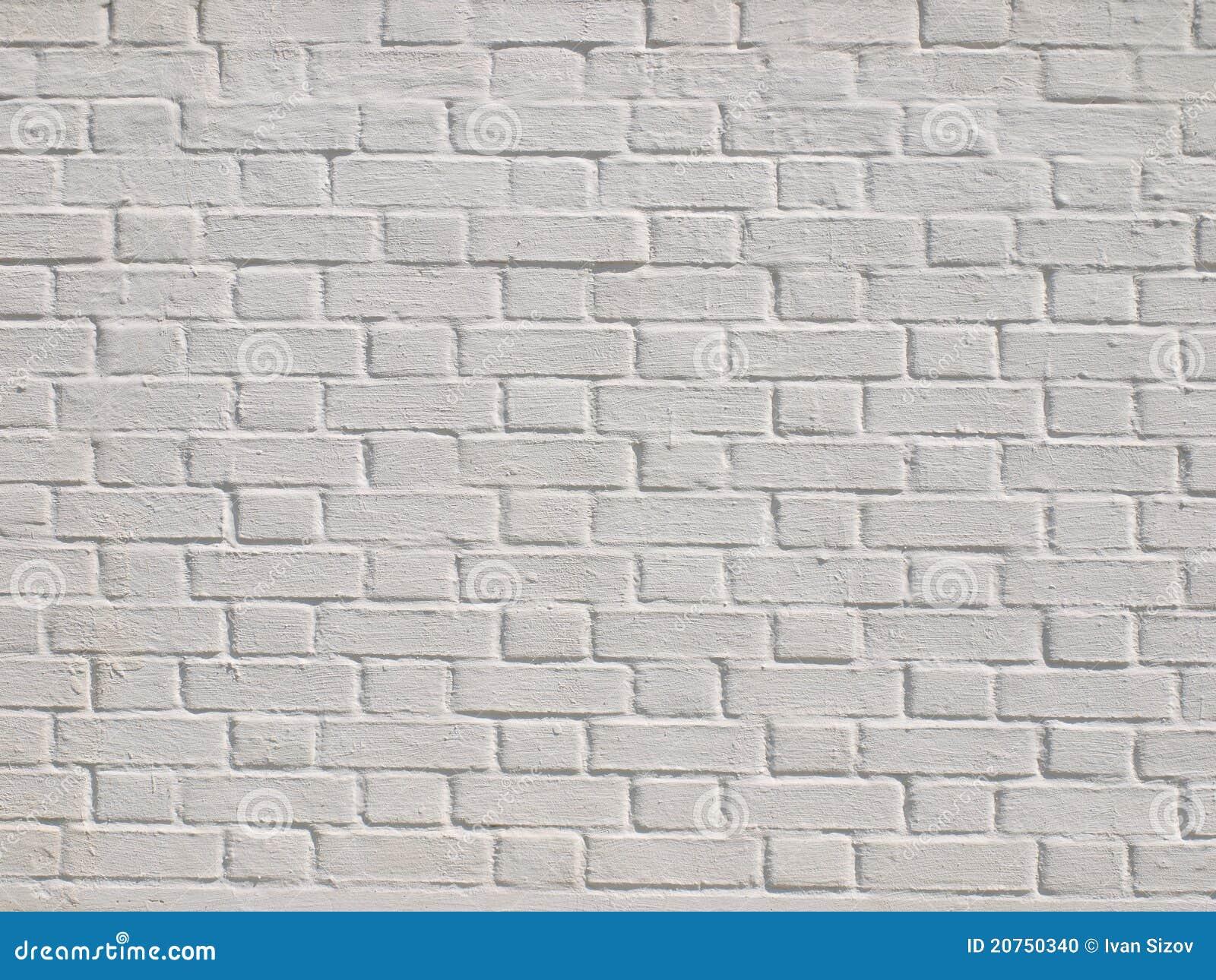 Un mur de briques blanc