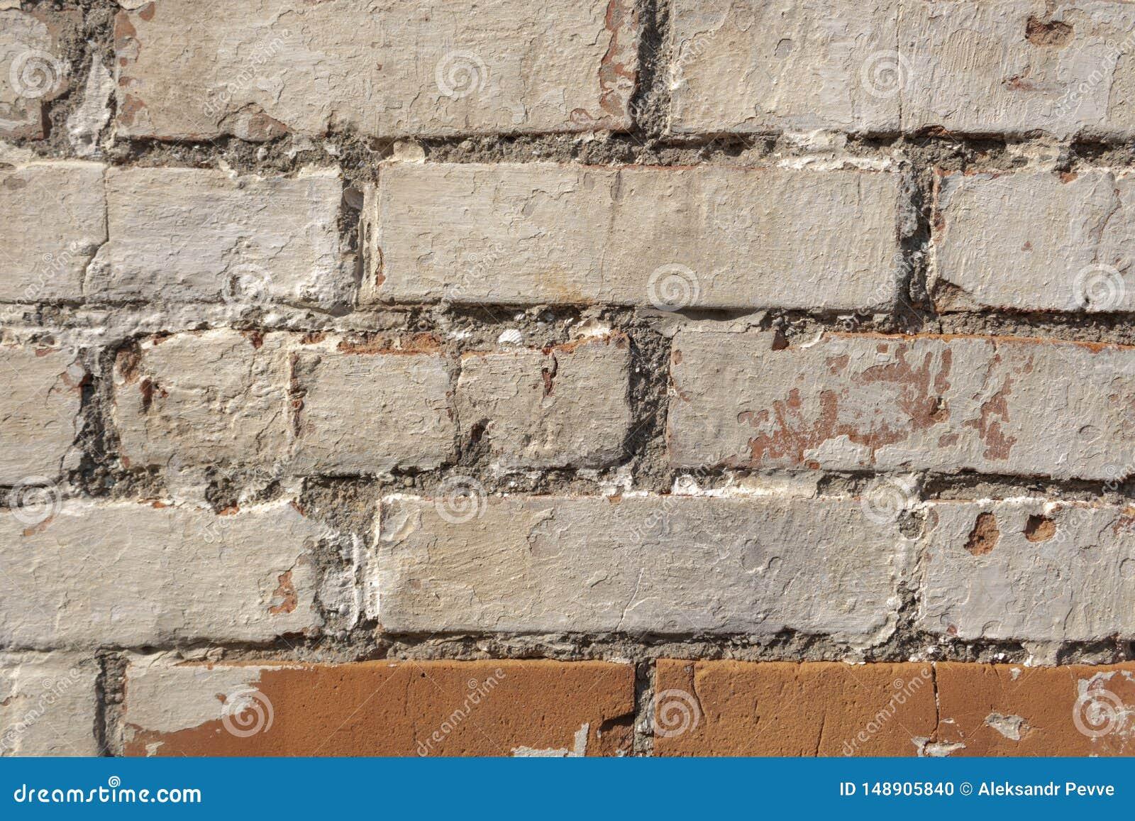 Un Mur Des Briques A Les Signes Clairs Des Effets Du Temps