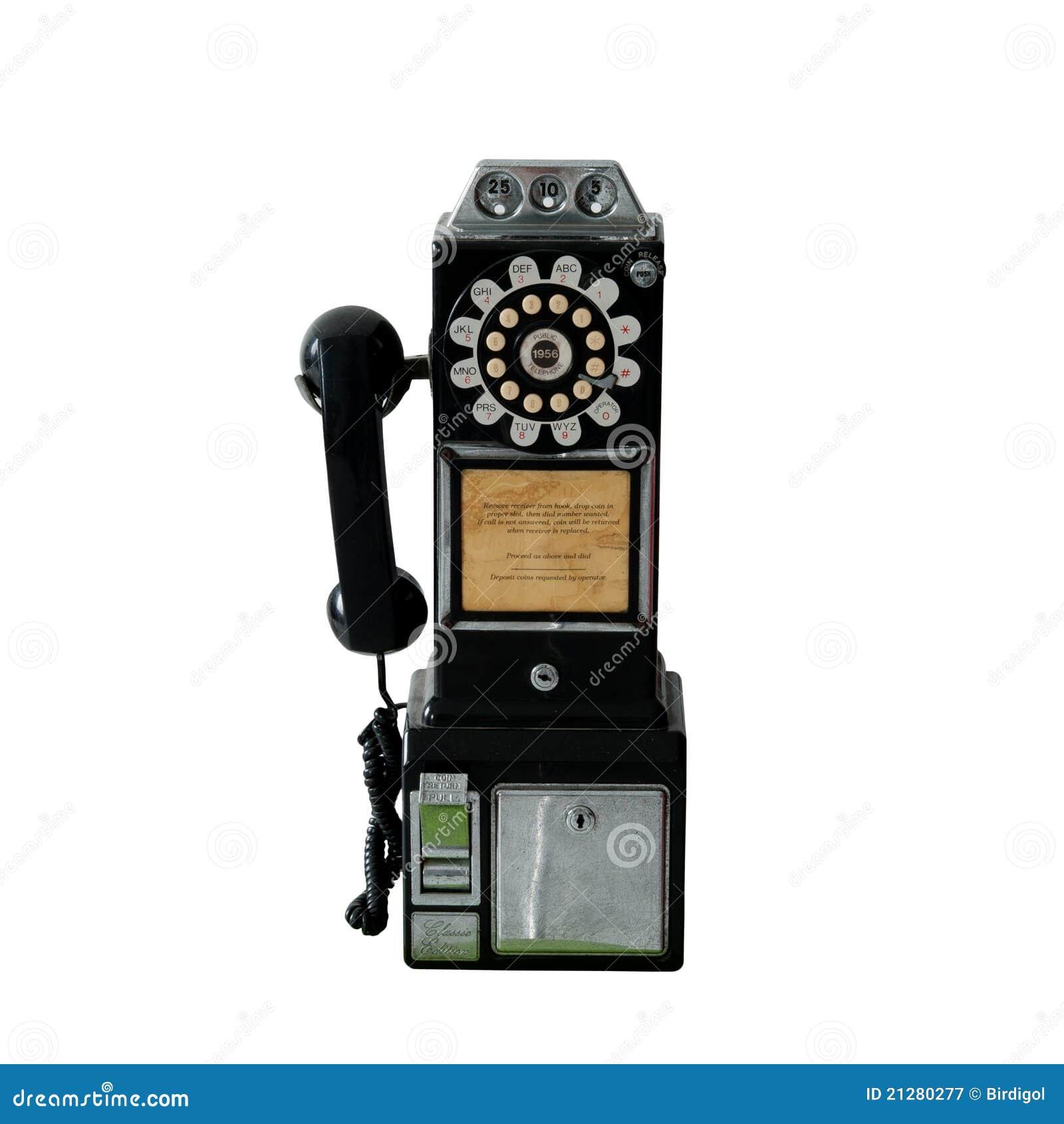 Un téléphone de salaire public de vieux cru d isolement sur le blanc