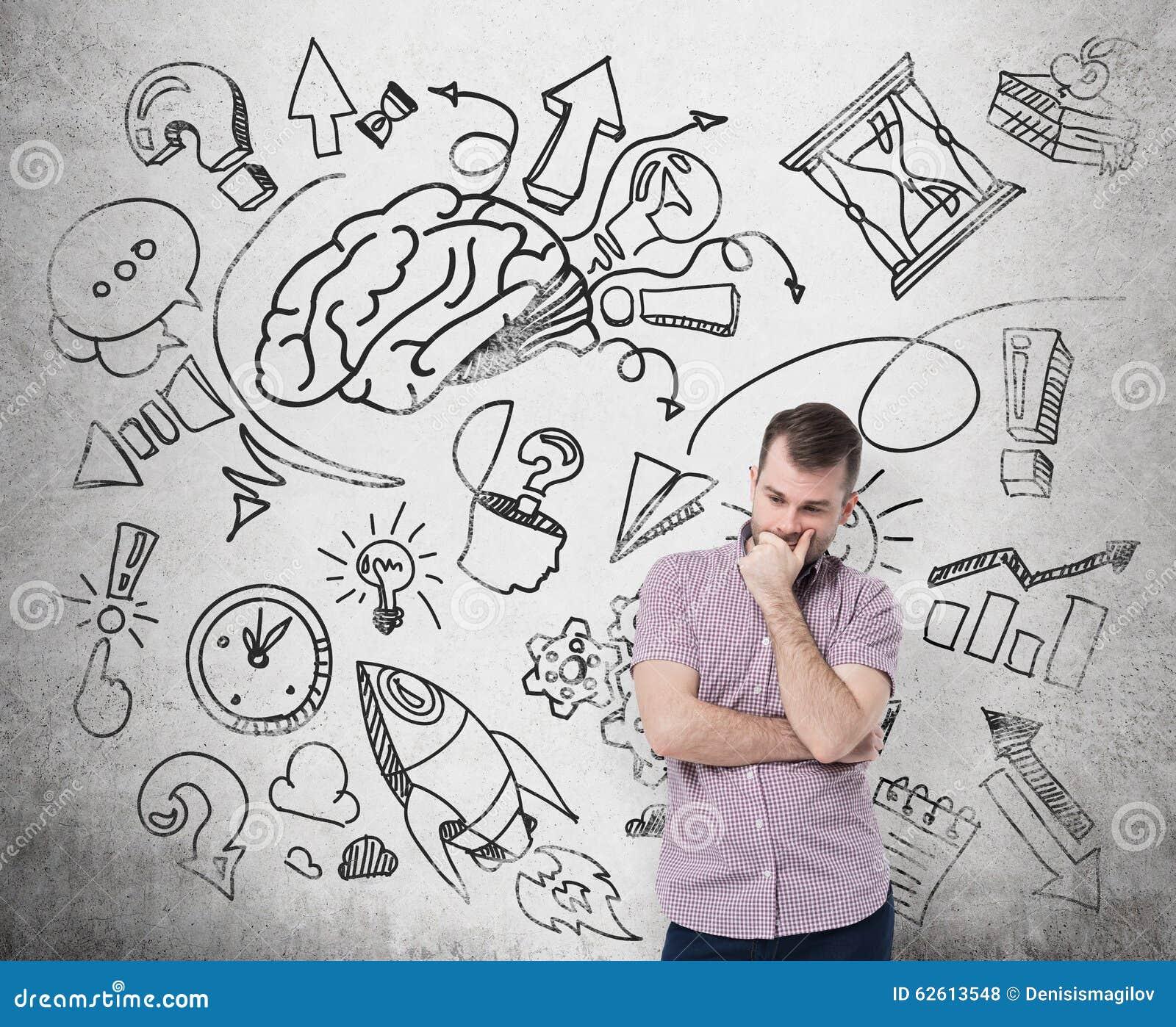 Un uomo bello in abbigliamento casual sta pensando a sviluppo di affari Uno schizzo di lampo di genio è attinto il muro di cement