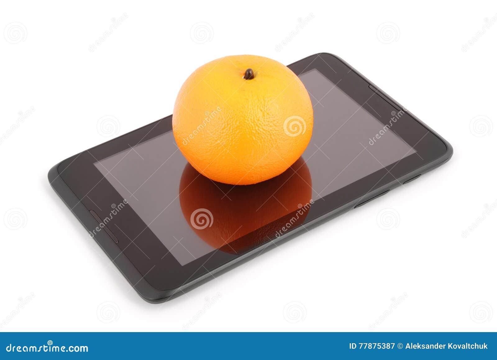 Una Fruta Anaranjada En La Tableta Y El X28; Path& X29 Del Recortes; Foto de archivo
