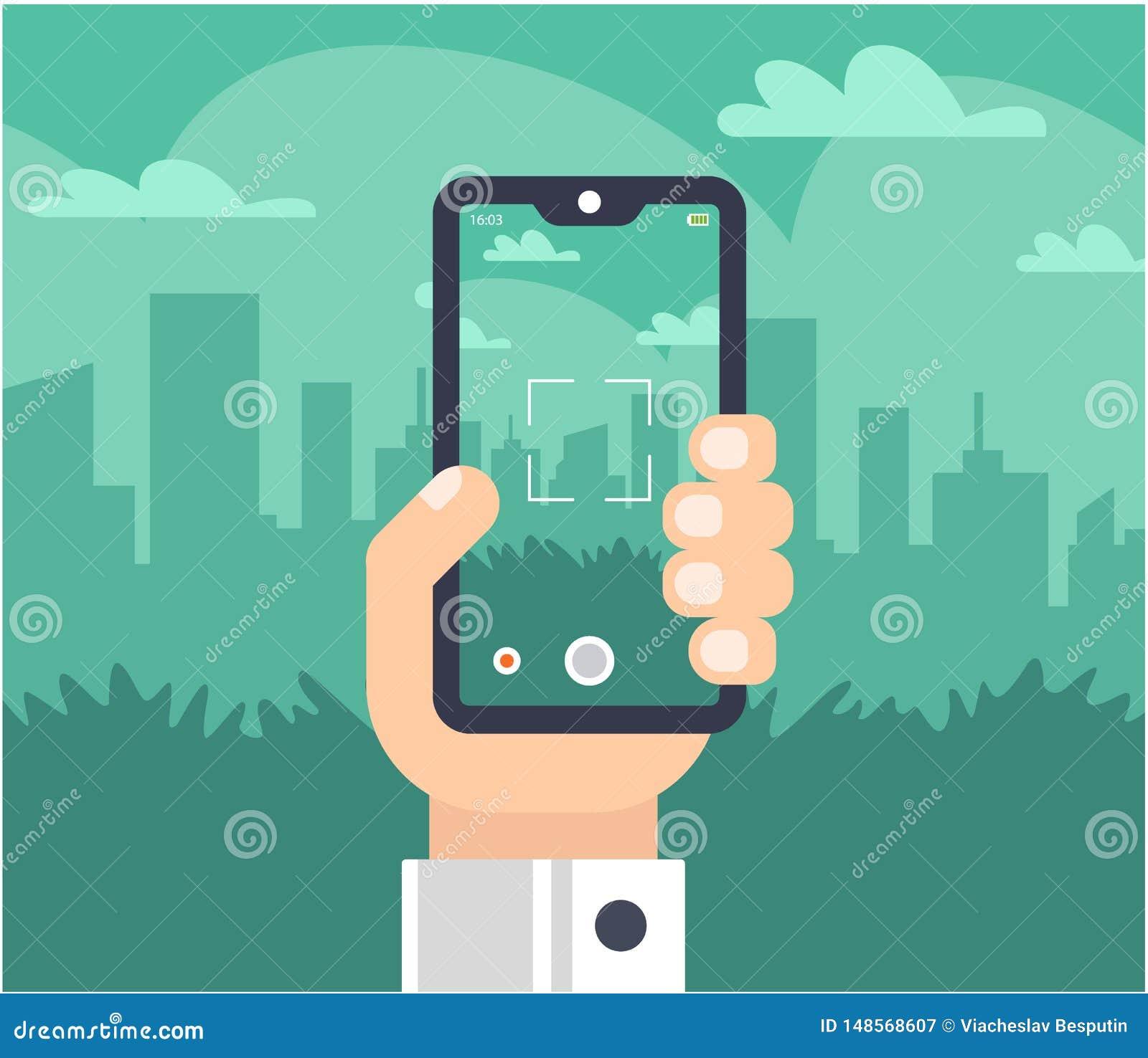 Una mano con un teléfono toma las imágenes de la ciudad