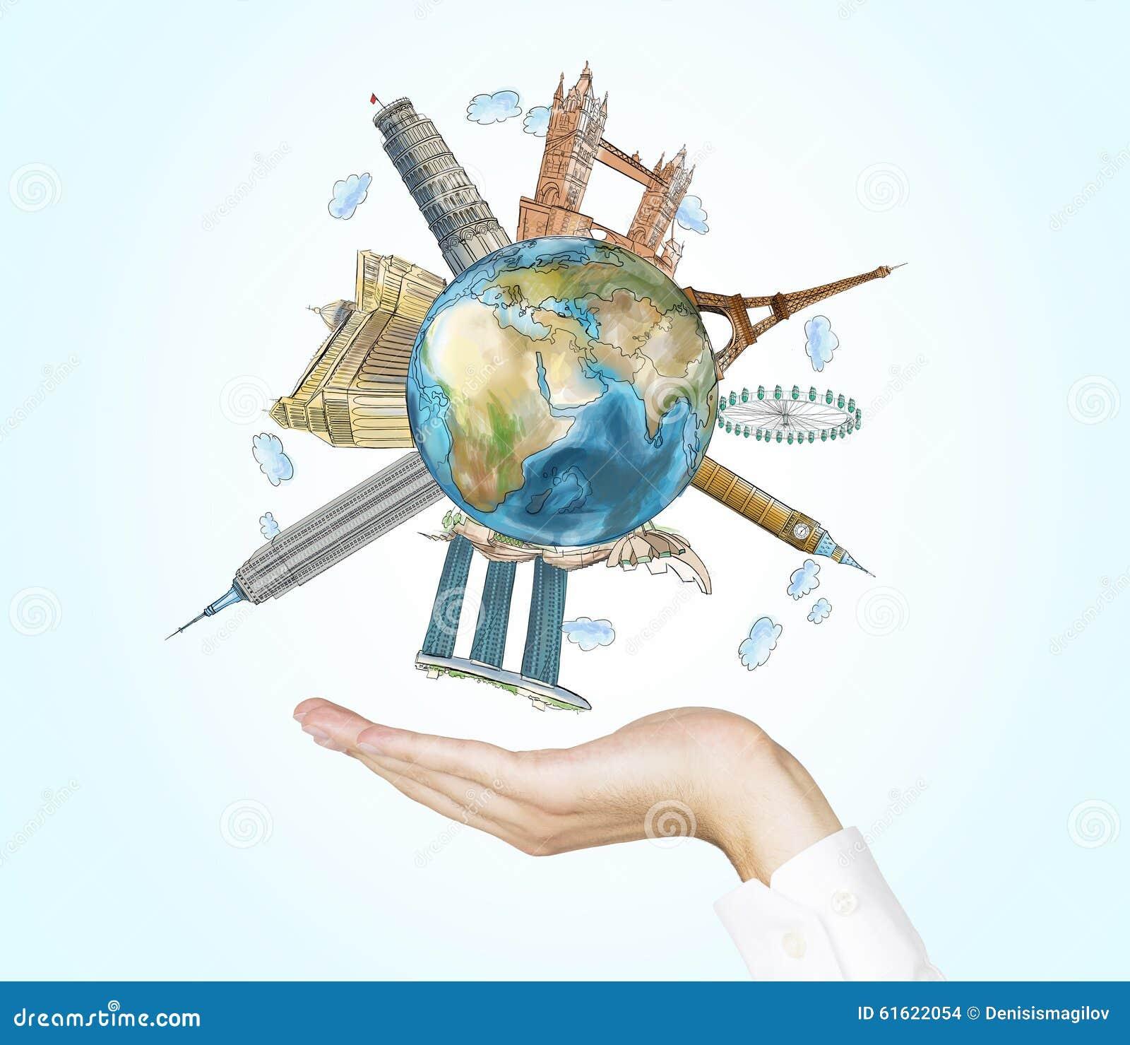Una mano sostiene un globo con bosquejó los lugares más famosos en el mundo Un concepto de turismo y de visita turística de excur