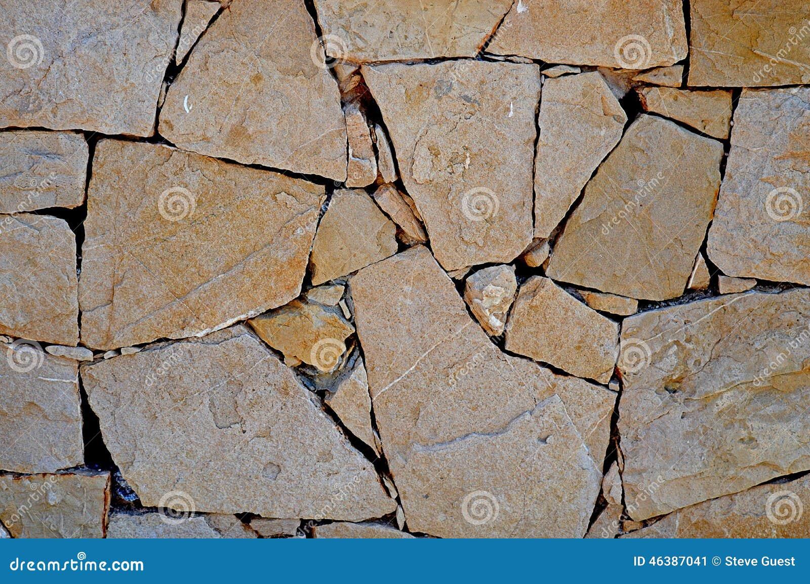 Una pared de piedra del mosaico para el fondo imagen de - Pared de piedra ...