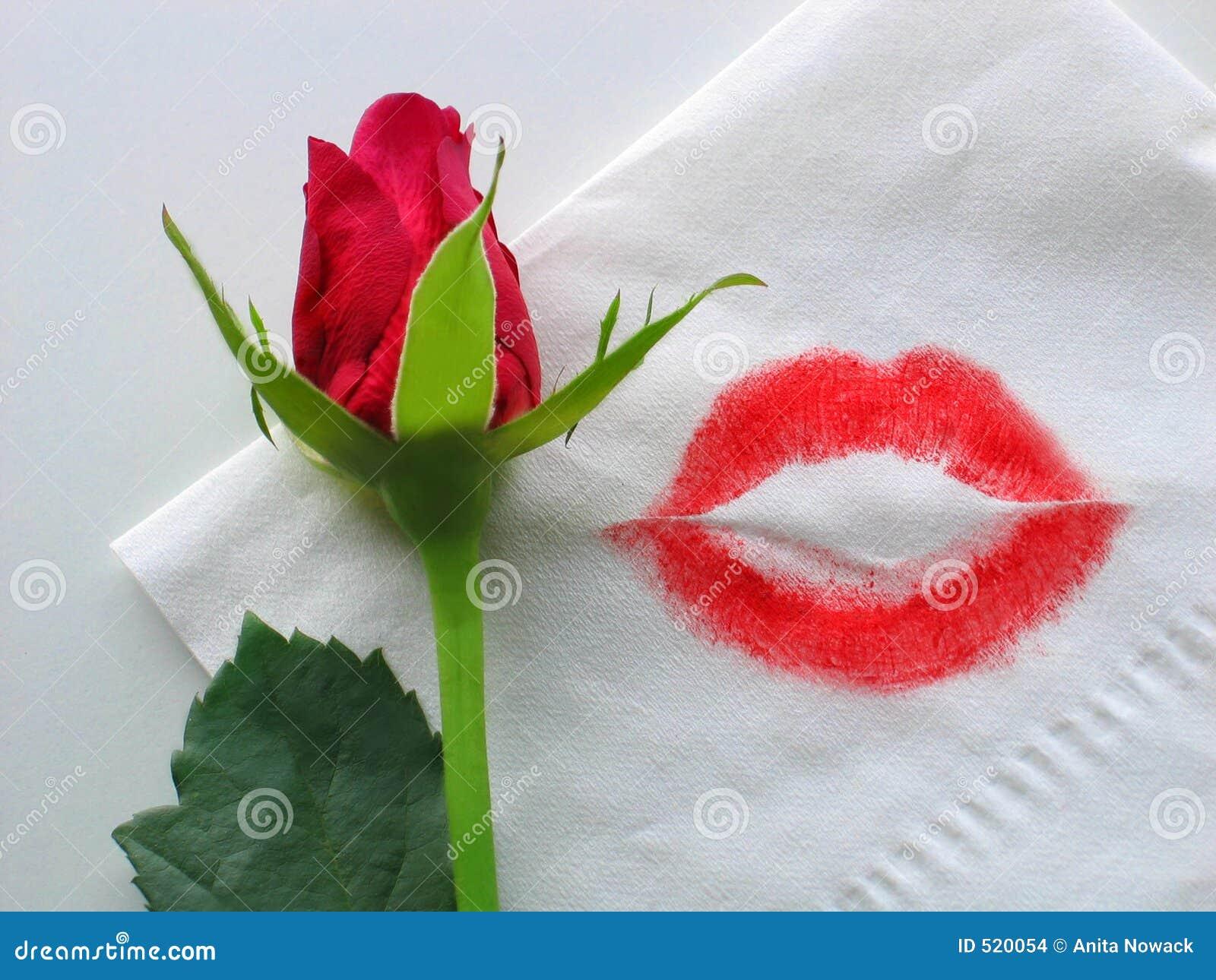 Una rosa y un beso del lápiz labial