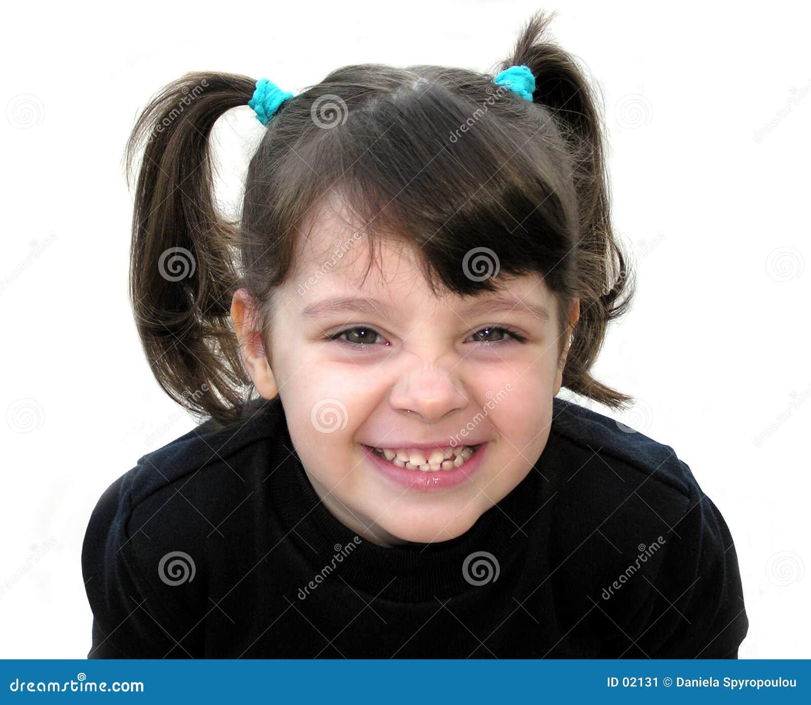 Download Una sonrisa de la niña imagen de archivo. Imagen de ojos - 2131