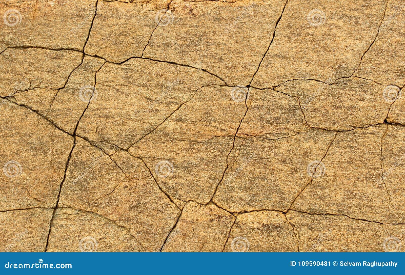 Una struttura orizzontale dello sfondo naturale di struttura incrinata della roccia