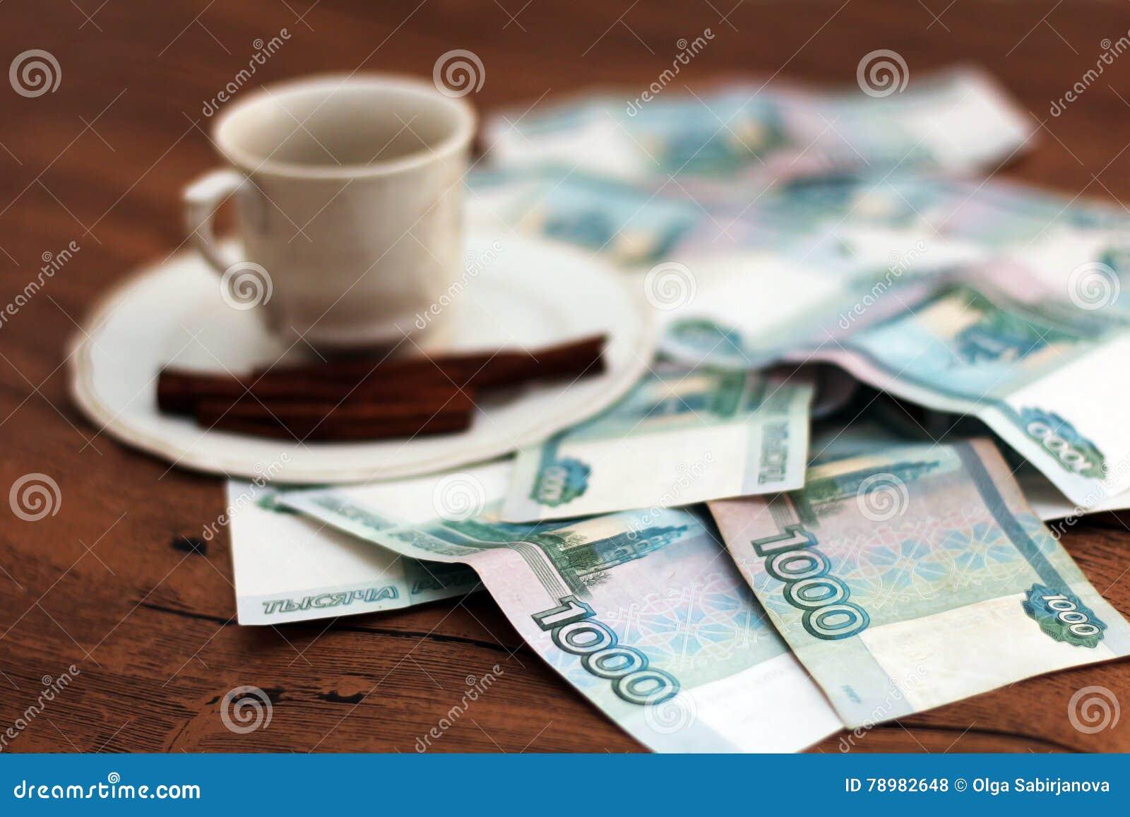 Una tazza di caffè ed i soldi