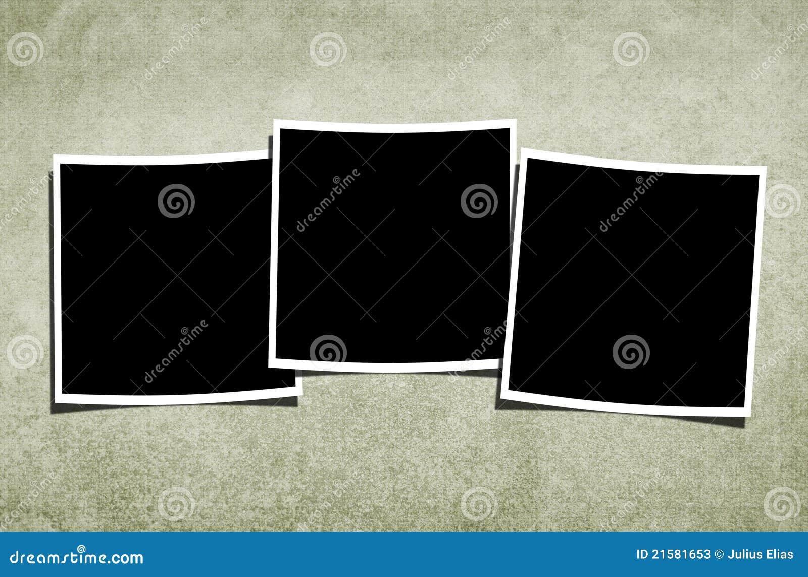 Unbelegte Polaroide über Weinlese-Hintergrund